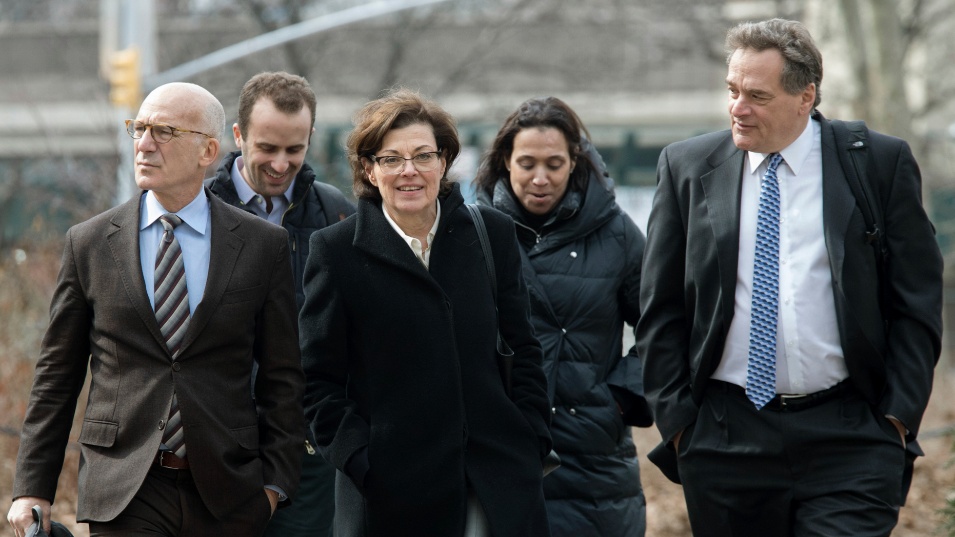 Nancy Salzman, center, arrives at Brooklyn federal court on Wednesday.