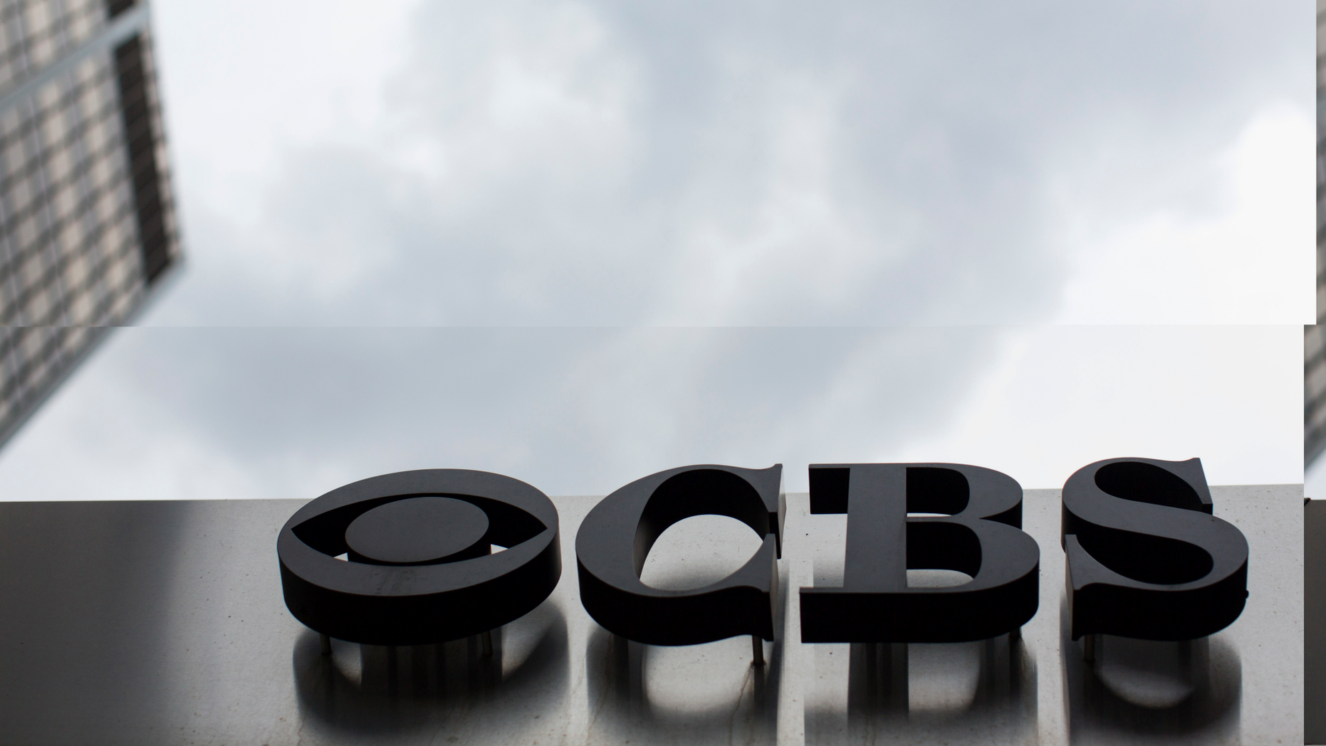 This photo shows the CBS logo at the company's broadcast center in New York. (Associated Press)