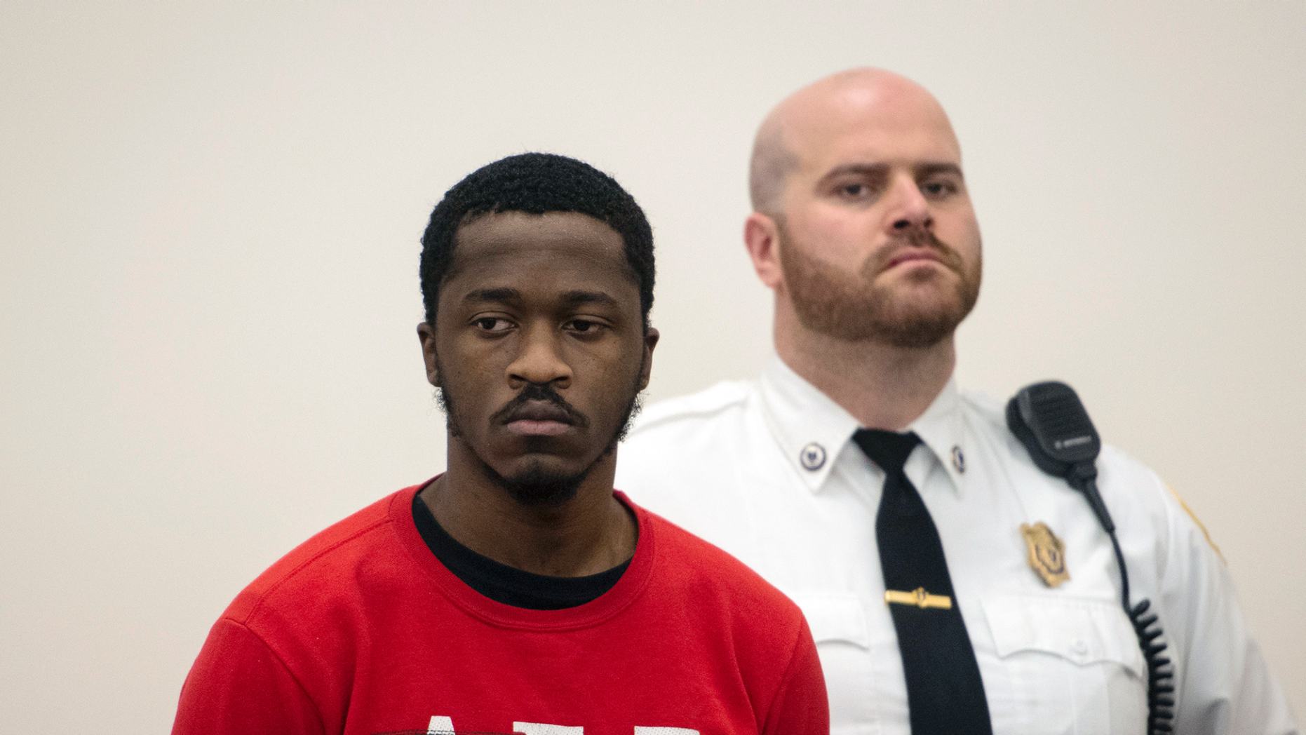 Momoh Kamara, 21, of West Boylston, appears in Worcester Superior Court, Friday, March 15, 2019 in Worcester, Mass. Worcester District Attorney Joseph Early Jr. announced Friday that a former tenant, 21-year-old Momoh Kamara, had been indicted on second-degree murder, arson and burglary charges. (Ashley Green/Worcester Telegram & Gazette via AP)