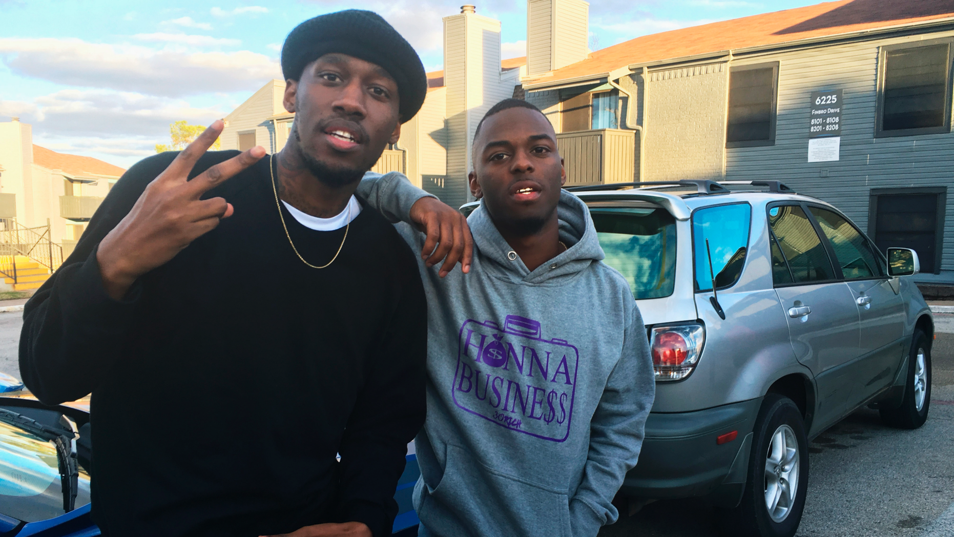 """In this Dec. 27, 2018, photo, video blogger Shawn Cotton, left, poses for a portrait with rapper Wayne Walker, who performs under the stage name 30 Rich, after Cotton interviewed Walker for his YouTube channel """"Say Cheese TV,"""" in Fort Worth, Texas. The killing of Zack Stoner, a pioneer in a new genre of news in which videographers interview street gangs and rappers in high-crime areas, has unnerved other gangland reporters nationwide, including Cotton. (AP Photo/John L. Mone)"""