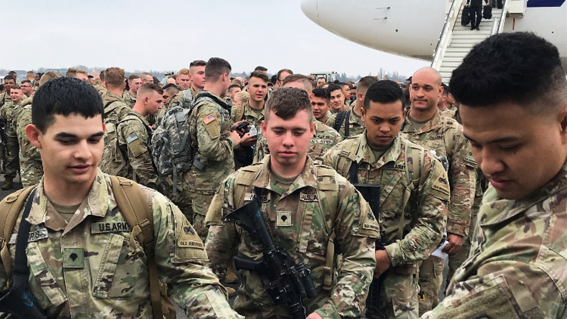Soldiers from the 1st Armored Division, based in Fort Bliss, Texas, arrives at the airport Tegel in Berlin, Thursday, March 21, 2019. Over three hundred soldiers have arrived in Germany from their base in Texas in the first test of a new American strategy to rapidly deploy troops based in the United States to Europe to bolster the NATO deterrent against possible Russian aggression. (AP Photo/Dorothee Thiesing)