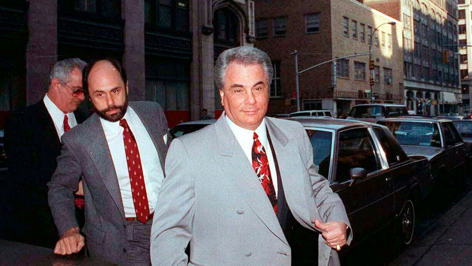 "FILE - In this Feb. 9, 1990 file photo, John Gotti, right, arrives at court in New York. The Gambino family was once among the most powerful criminal organizations in the U.S., but federal prosecutions in the 1980s and 1990s sent Gotti and other top leaders to prison, diminishing its reach. The last Mafia boss to be shot to death in New York City was Gambino don Paul Castellano, assassinated outside a Manhattan steakhouse in 1985 at the direction of Gotti, who then took over the organization. On Wednesday, March 13, 2019, Francesco ""Franky Boy"" Cali, the reputed boss of New York's Gambino crime family was gunned down outside his home, dying a virtual unknown compared with his swaggering 1980s-era predecessor, the custom-tailored tabloid regular Gotti. (AP Photo/David Cantor, File)"