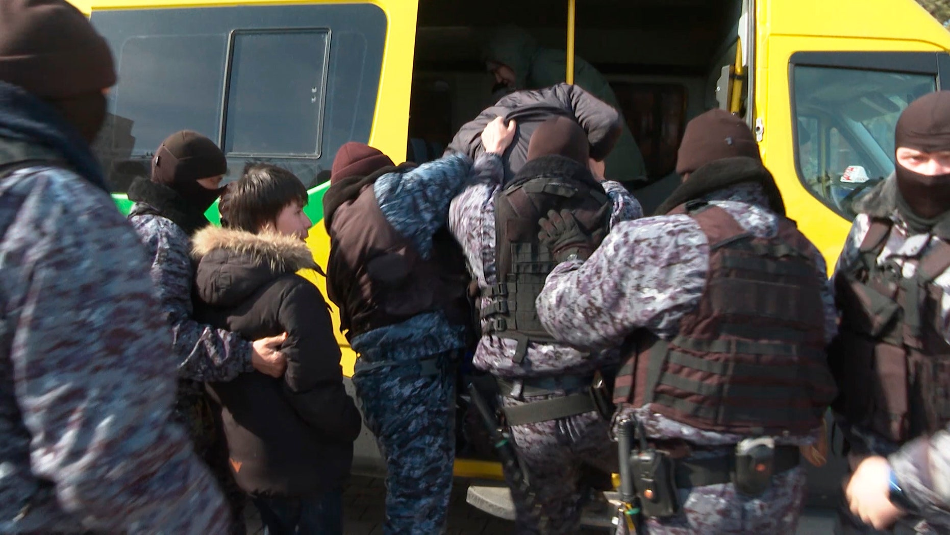 In this video grab from Radio Free Europe/Radio Liberty stream video, taken on Thursday, March 21, 2019, police officers detain a small group of people who were protesting against the renaming of the capital city, in central Astana, Kazakhstan.  Kazakhstan has renamed its capital city Astana, now calling it Nursultan, to honour outgoing President Nursultan Nazarbayev, who unexpectedly resigned on Tuesday. (Serhii Nuzhnenko/Radio Free Europe/Radio Liberty via AP)