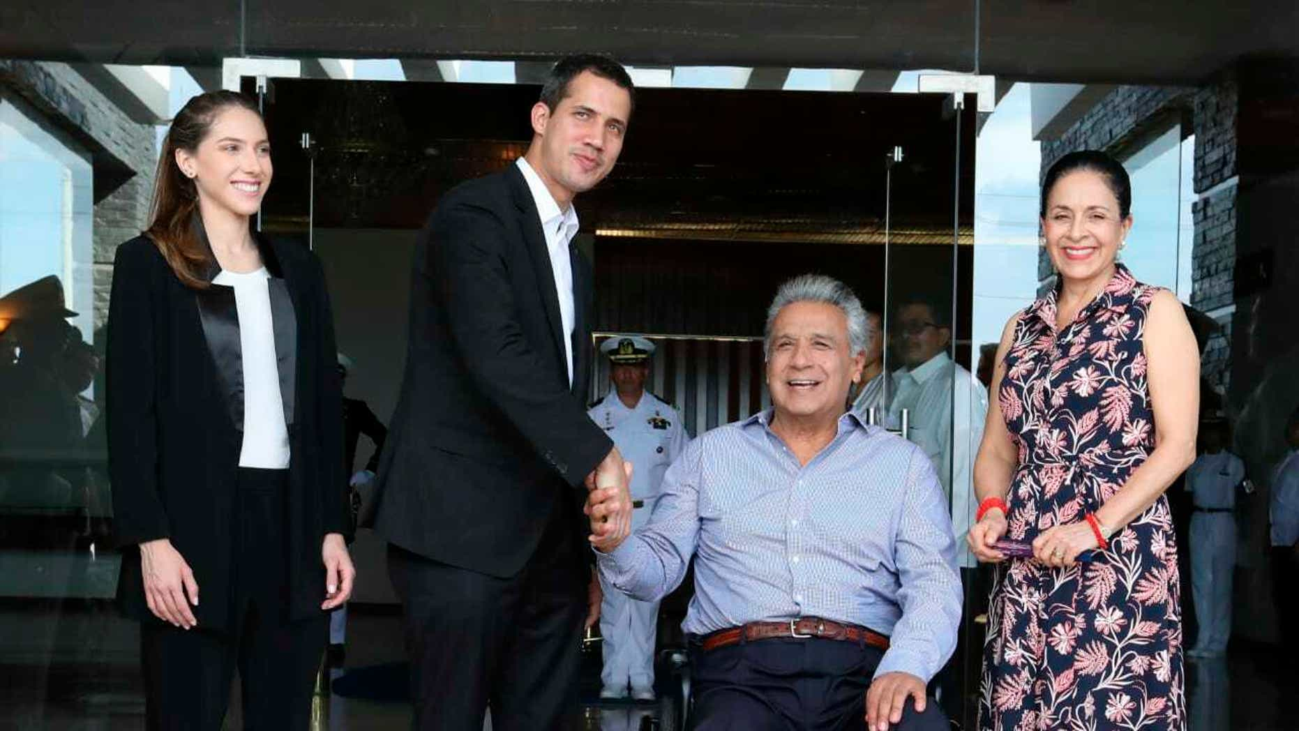 In this photo provided by Ecuador's Presidential Office, Ecuador's President Lenin Moreno, center right, and his wife Rocio Gonzalez, right, welcome Venezuela's self-declared interim president Juan Guaido, center left, and his wife Fabiana Rosales during a meeting in Salinas, Ecuador. Saturday, Feb. 2, 2019. Guaido is in tour of several South American capitals as part of a campaign to build international pressure on his rival Nicolas Maduro to quit. (AP Photo/Ecuador's Presidency)