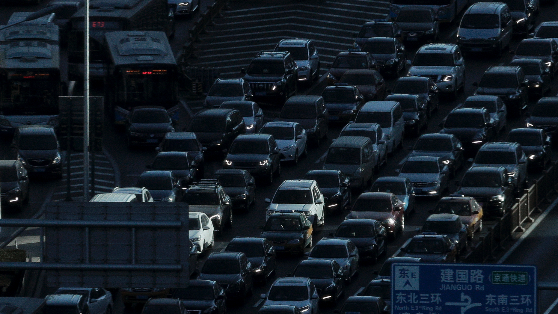 A beam of sunlight is cast on vehicles on a city ring-road clogged with heavy traffic during the morning rush hour in Beijing, Dec. 11, 2018. (Associated Press)