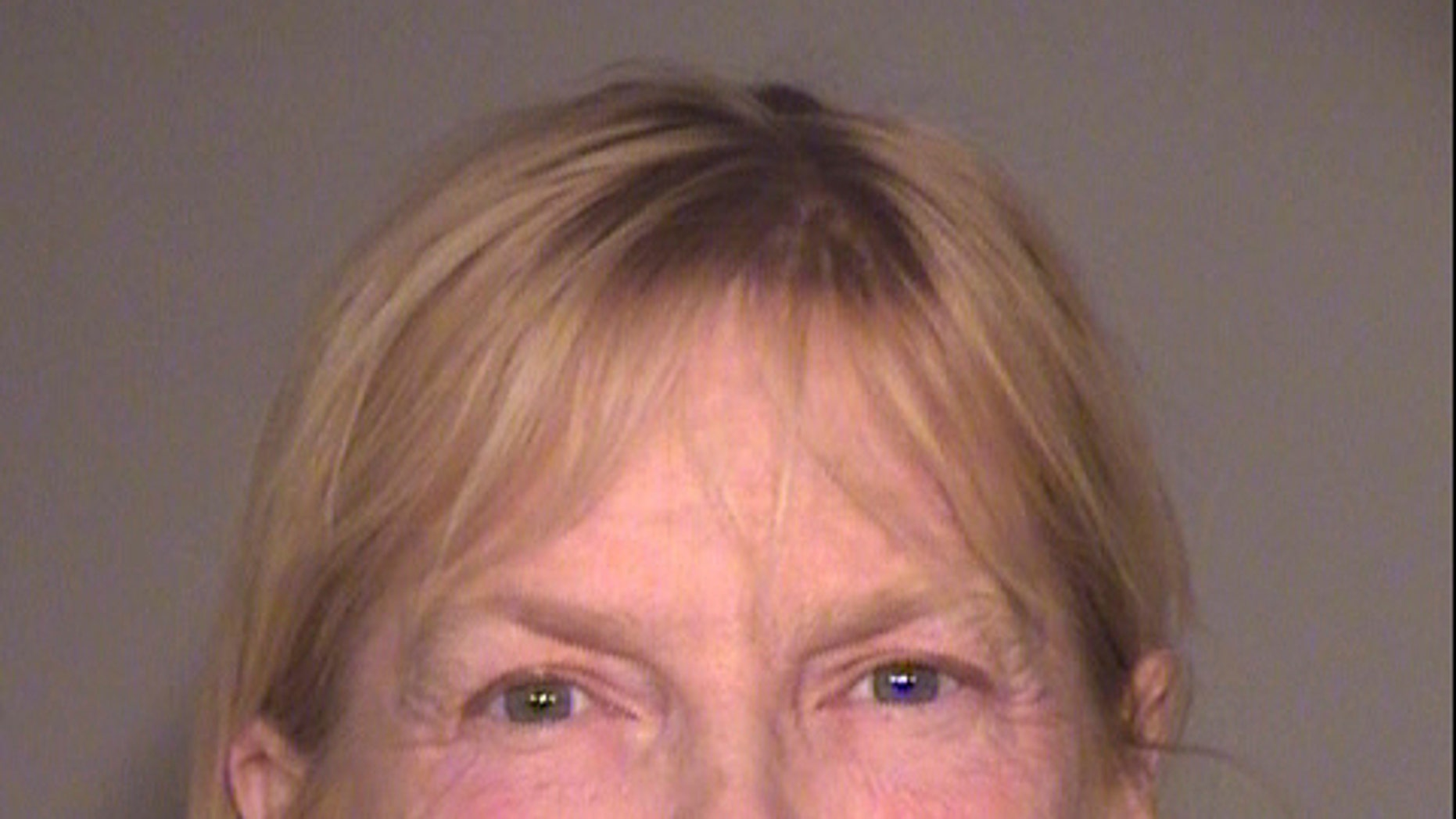 This undated booking photo provided by the Ventura County Sheriff's Office shows Catherine Ann Vandermaesen, of Ojai, Calif. Authorities say the Southern California woman is in custody after deputies discovered her 96-year-old father living in a home stinking of feces and filled with up to 700 rats. The Ventura County Sheriff's Office says Tuesday, March 19, 2019, that Vandermaesen was arrested on suspicion of elder abuse and animal neglect. (Ventura County Sheriff's Office via AP)