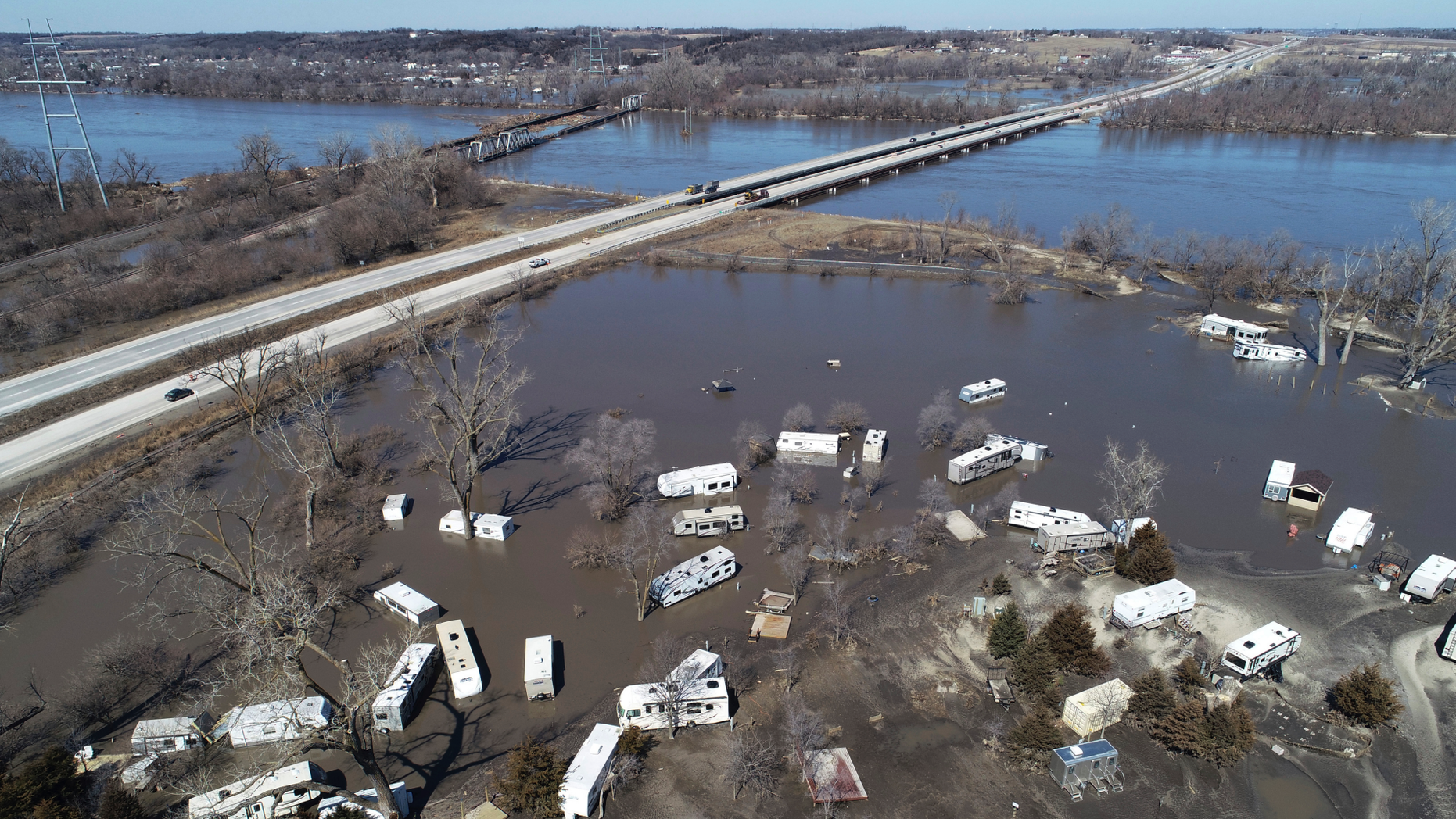 """This Wednesday, March 20, 2019 aerial photo shows flooding near the Platte River in in Plattsmouth, Neb., south of Omaha. The National Weather Service is warning that flooding in parts of South Dakota and northern Iowa could soon reach historic levels. A Weather Service hydrologist says """"major and perhaps historic"""" flooding is possible later this month at some spots on the Big Sioux and James rivers. The worst of the flooding so far has been in Nebraska, southwestern Iowa and northwestern Missouri. (DroneBase via AP)"""