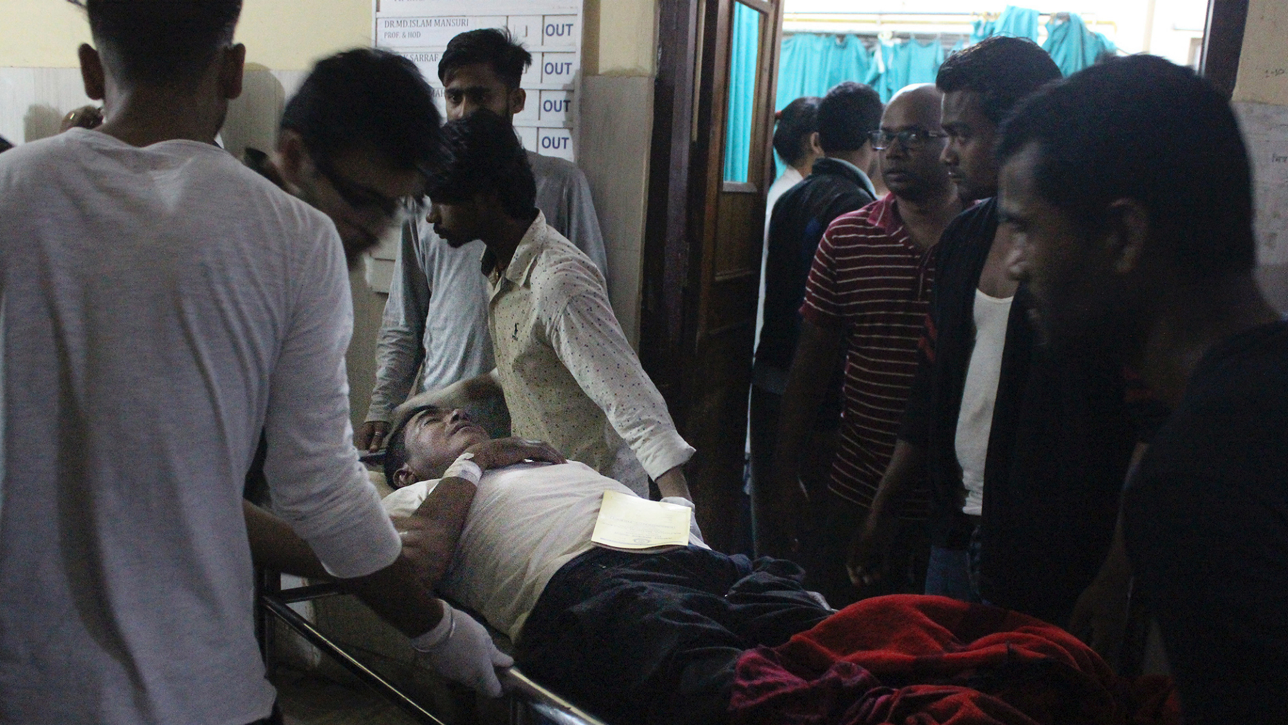 An Injured of rain storm from Bara district is being brought to a government hospital, in Birgunj, 136 kilometers (85 miles) from Kathmandu, Nepal, March 31, 2019. Officials say many people were killed and hundreds were injured by a rainstorm that swept southern Nepal on Sunday. (AP Photo/Jiyalal Sah)