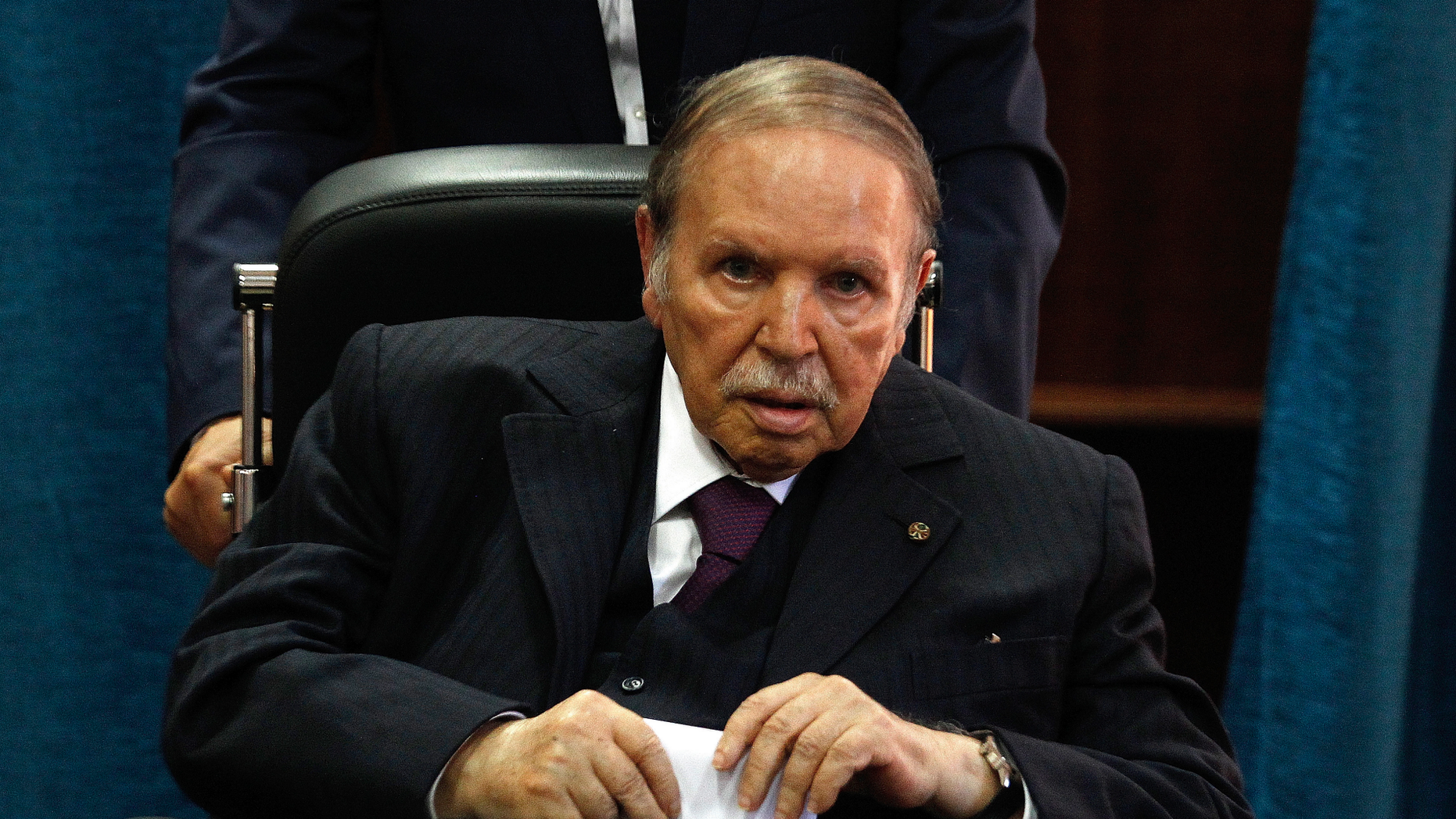 FILE - In this May 4, 2017 file photo, Algerian President Abdelaziz Bouteflika prepares to vote in Algiers. (AP Photo/Sidali Djarboub, File)