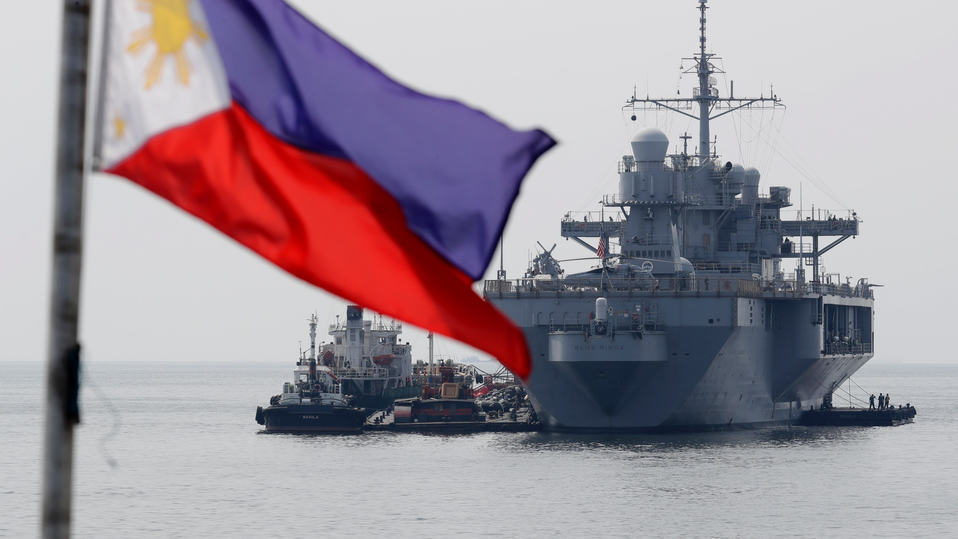 """The USS Blue Ridge (LCC-19), the U.S. 7th Fleet Flagship, is anchored off Manila Bay west of Manila, Philippines for a routine port call Wednesday, March 13, 2019. Capt. Eric Anduze, Commander of the USS Blue Ridge, renewed an American vow to """"sail, fly and operate wherever the law allows us to"""" amid China's objection to U.S. military presence in the disputed South China Sea. (AP Photo/Bullit Marquez)"""