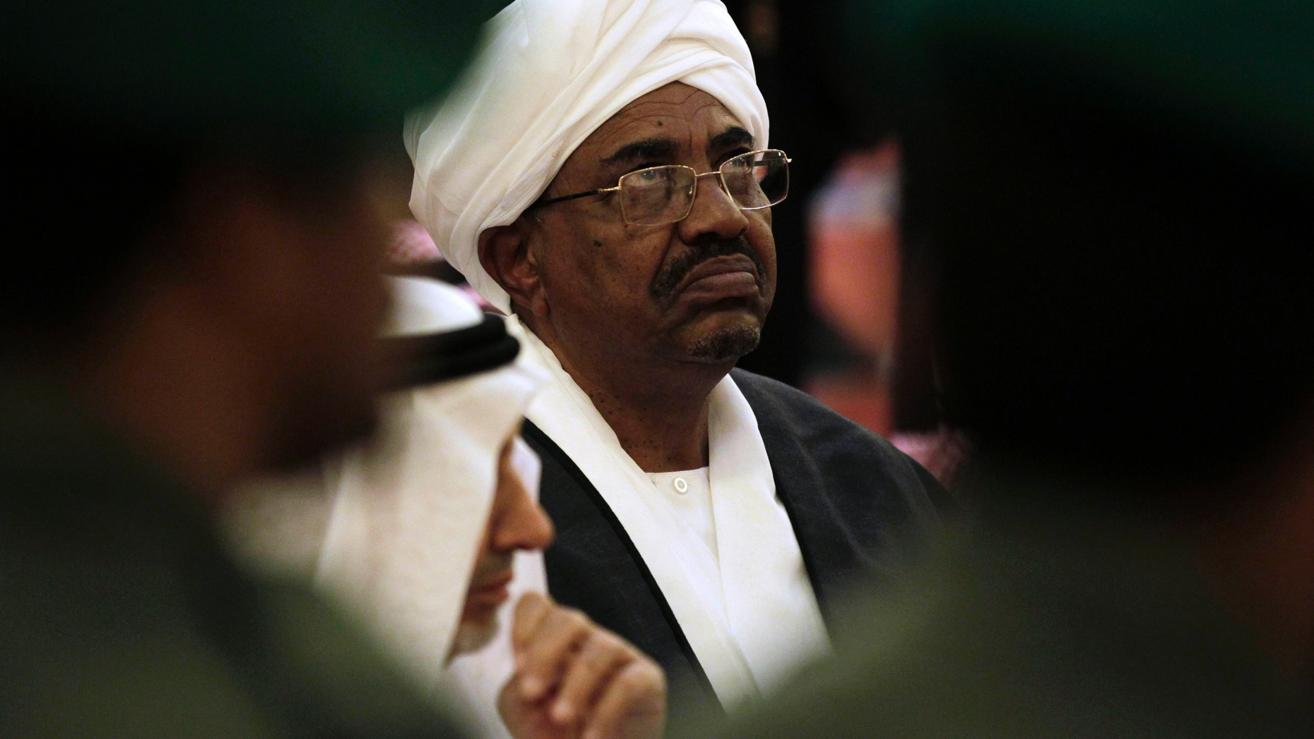 """FILE - In this Oct. 25, 2011 file photo, Sudanese President Omar al-Bashir attends the funeral of Saudi Crown Prince Sultan bin Abdul-Aziz Al Saud, in Riyadh, Saudi Arabia.  In a report issued Tuesday, March 27, 2019, New York-based Human Rights Watch described al-Bashir as a """"fugitive from international justice"""" because he is wanted by the International Criminal Court for charges of genocide linked to the Darfur conflict. The rights group urged Tunisia to either """"bar or arrest"""" Sudanese President Omar al-Bashir if he tries to attend an Arab League summit this weekend. (AP Photo/Hassan Ammar, File)"""