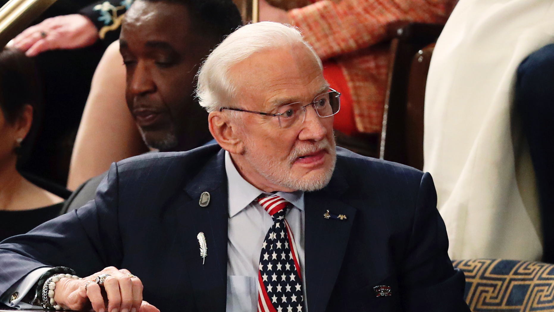 FILE - In this Feb. 5, 2019, file photo, astronaut Buzz Aldrin arrives for President Donald Trump's State of the Union address to a joint session of Congress on Capitol Hill in Washington. A legal fight between Aldrin and his adult children over whether the former astronaut was competent to manage his affairs ended Wednesday, March 13, averting a messy, intrafamily squabble from hanging over celebrations this summer of the 50th anniversary of his Apollo 11 moon-walking. (AP Photo/Andrew Harnik, File)