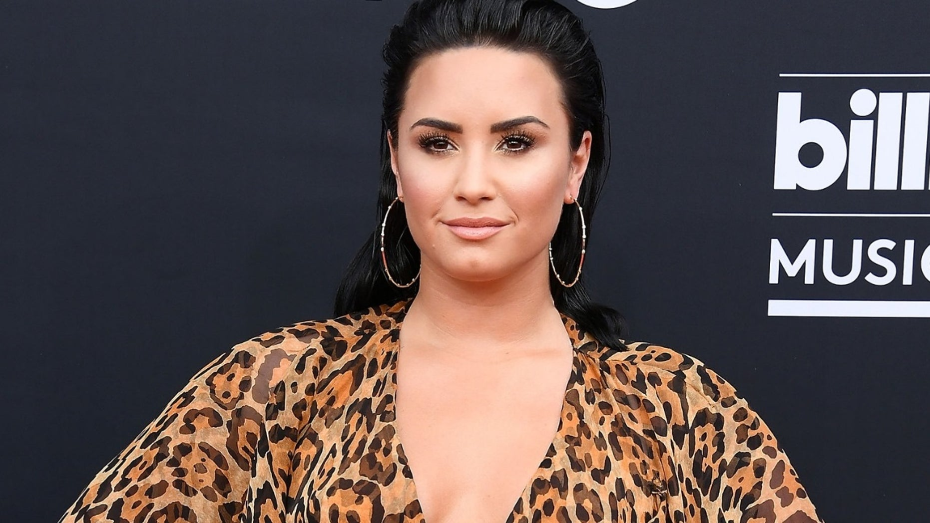 Singer Demi Lovato appeared shocked to learn that she had knocked out her trainer's front tooth while working out.