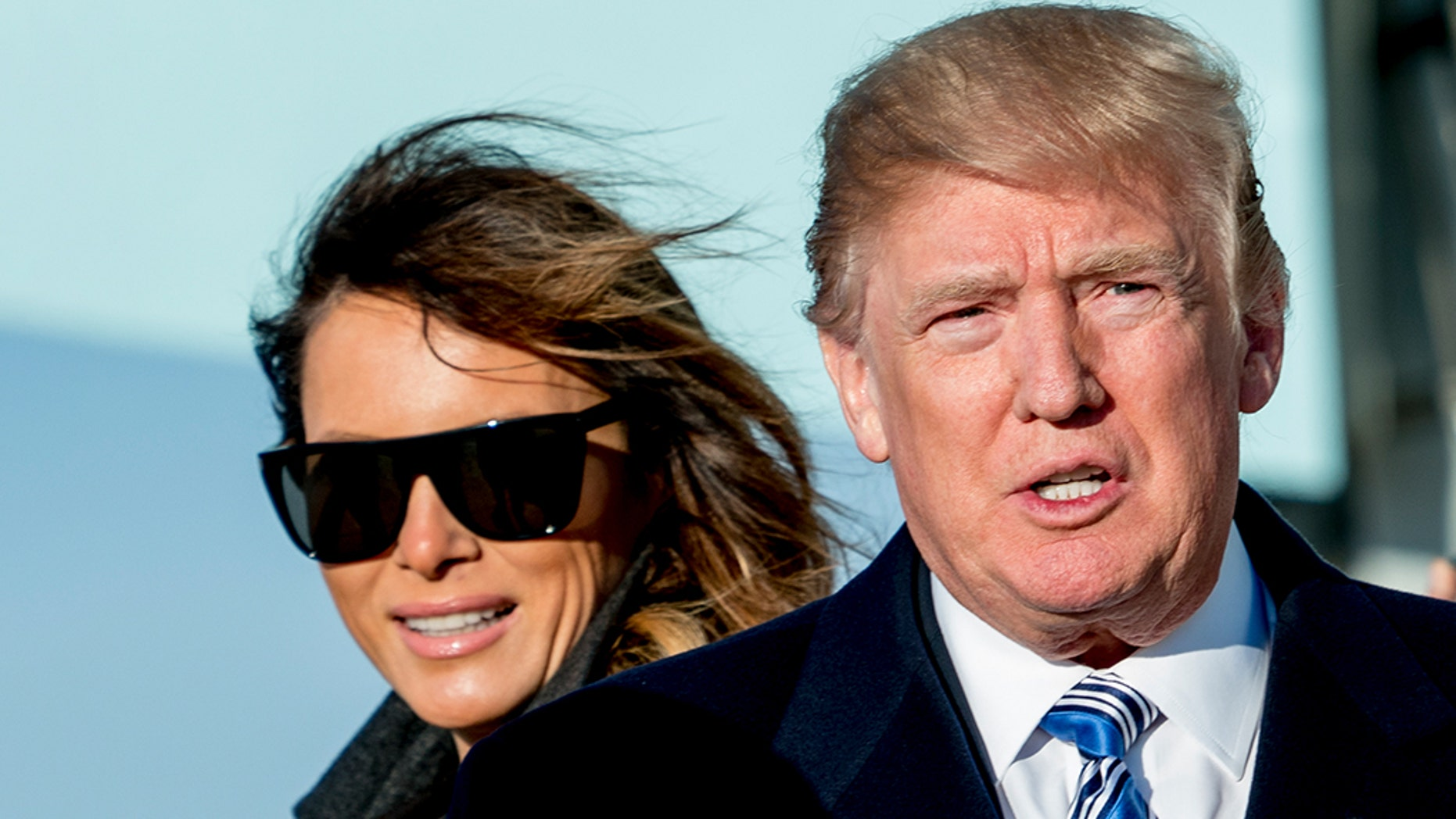 President Trump and first lady Melania arrive at Andrews Air Force Base, Md., Saturday. (AP Photo/Andrew Harnik)