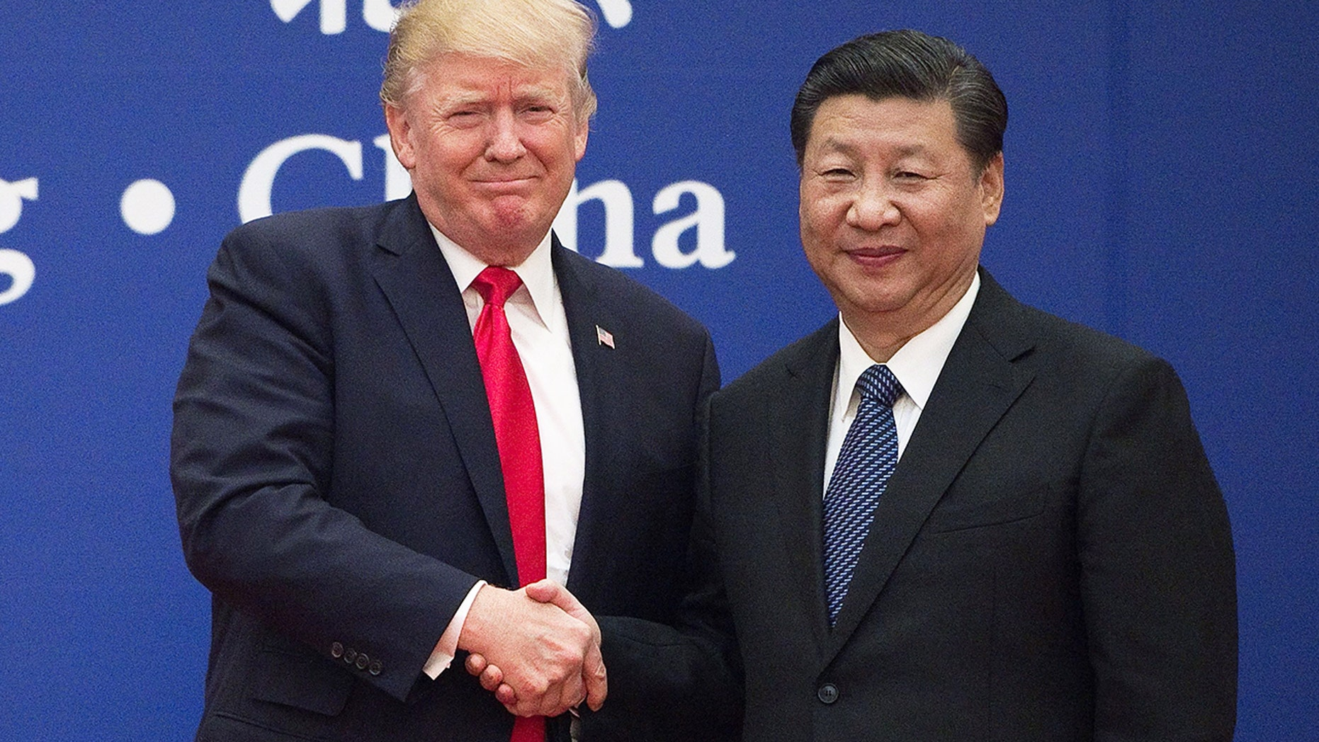 FILE: President Donald Trump and Chinese President Xi Jinping shake hands under a business manager at The Great Hall of the People in Beijing. (Getty)