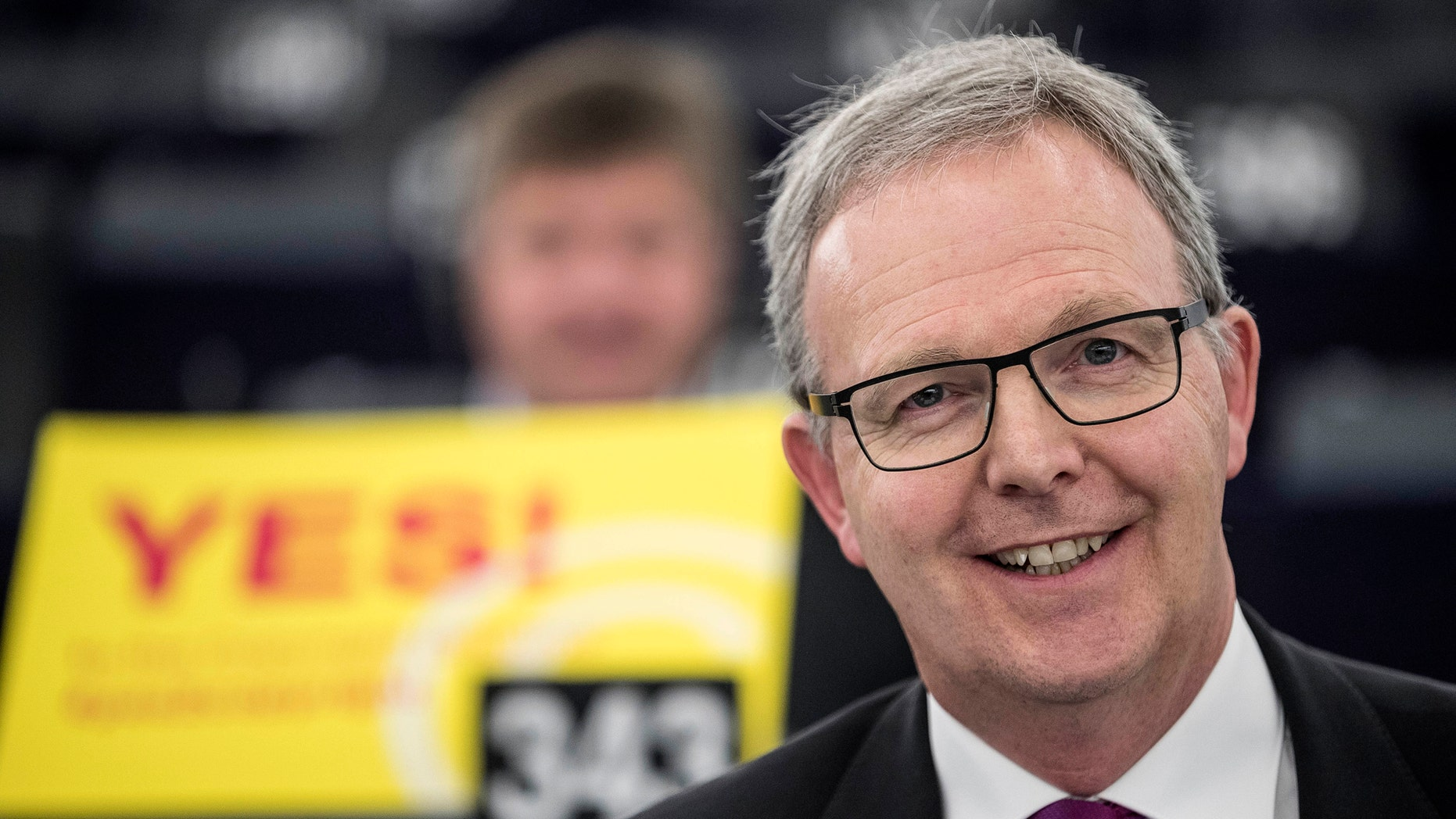 Axel Voss, Member of a European Parliament and rapporteur of a copyright bill, poses for a media during a European Parliament in Strasbourg, France, Tuesday Mar 26, 2019. The European Parliament is furiously debating a pros and cons of a landmark copyright check one final time before a legislature will opinion on it later. (AP Photo/Jean-Francois Badias)