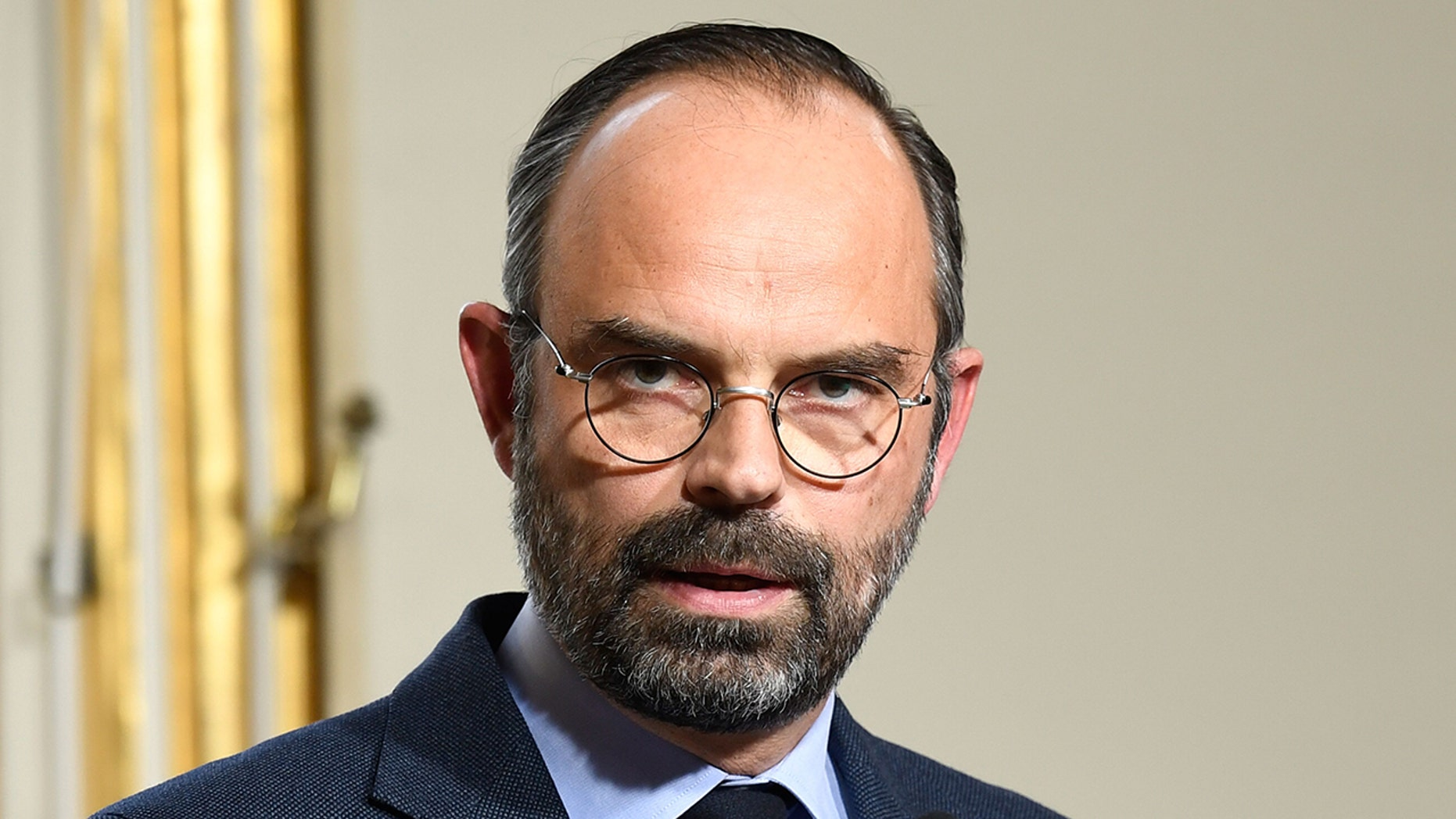 French Prime Minister Edouard Philippe (L) gives a press conference, on March 18, 2019 at the Matignon hotel in Paris, to announce measures after weekend riots. (Photo by Bertrand GUAY / AFP) (Photo credit should read BERTRAND GUAY/AFP/Getty Images)