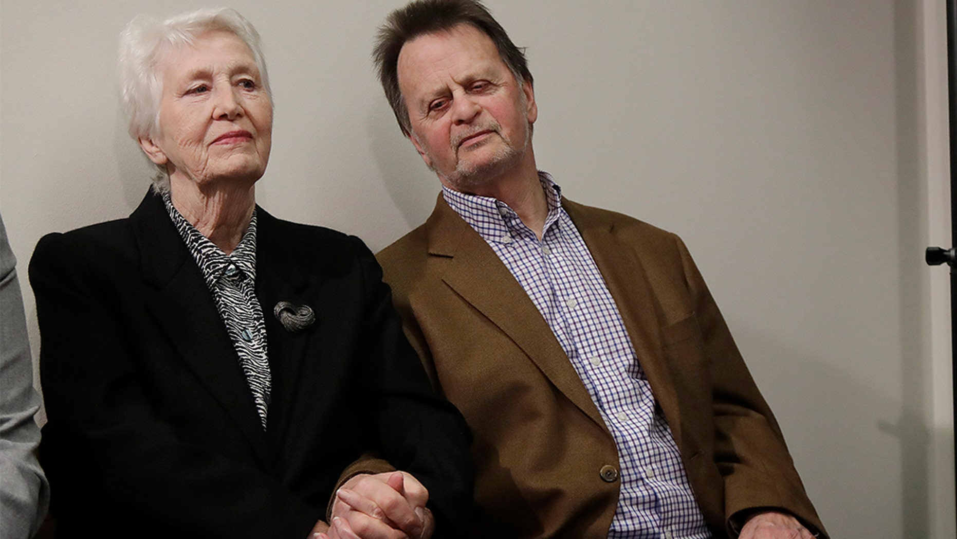 Edwin Hardeman, right, sits with his wife, Mary, at a news conference in San Francisco, Wednesday. (AP Photo/Jeff Chiu)