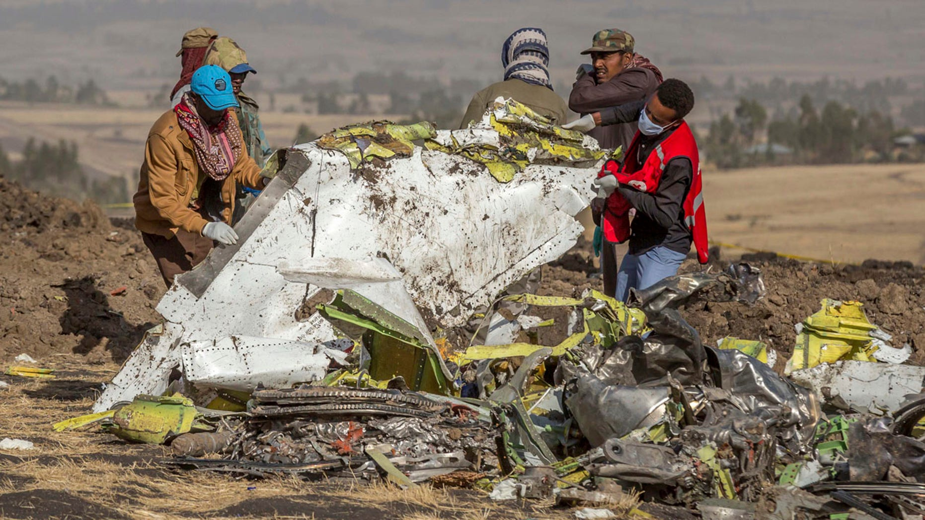 Boeing and the Federal Aviation Administration rushed the approval of the security system in the 737 MAX and overlooked important flaws that may have contributed to the crashes in Indonesia and Ethiopia, according to current and former engineers. Rescuers are pictured here recovering wreckage from the Ethiopian Airlines flight, which crashed on March 10