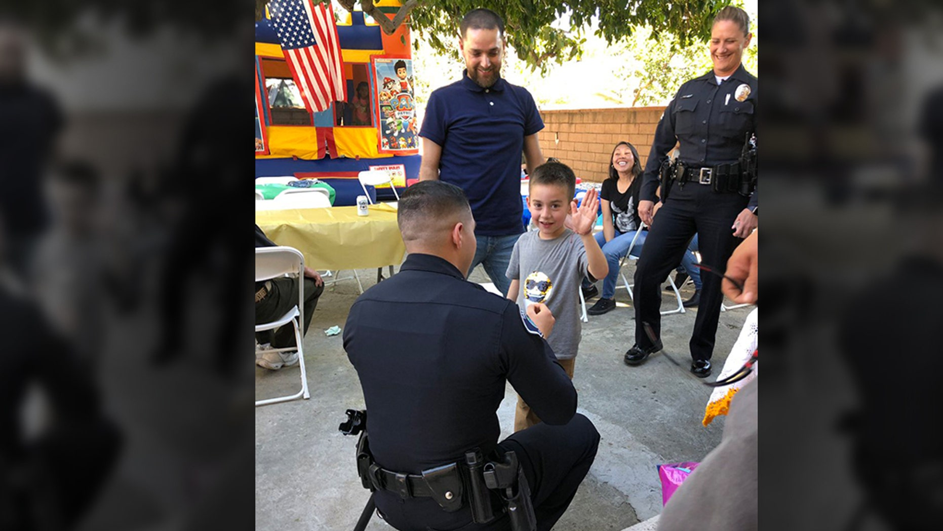 """The Santa Ana Police Department sent over a few of its officers to Ewinn's party Saturday afternoon — """"to swear him in as a Jr. officer."""" (Santa Ana Police Department)"""