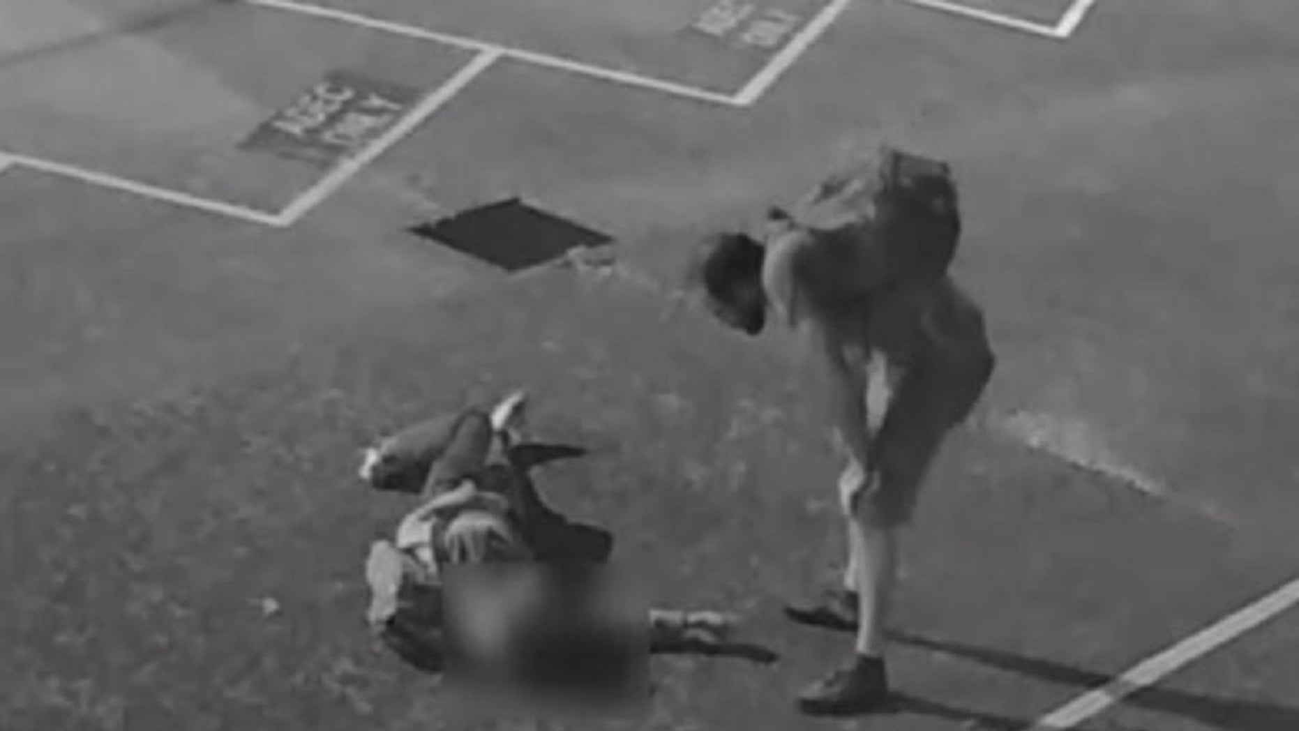 A screenshot from a surveillance video shows a suspect who, according to the police, is over an unidentified American tourist who was severely beaten in Australia.