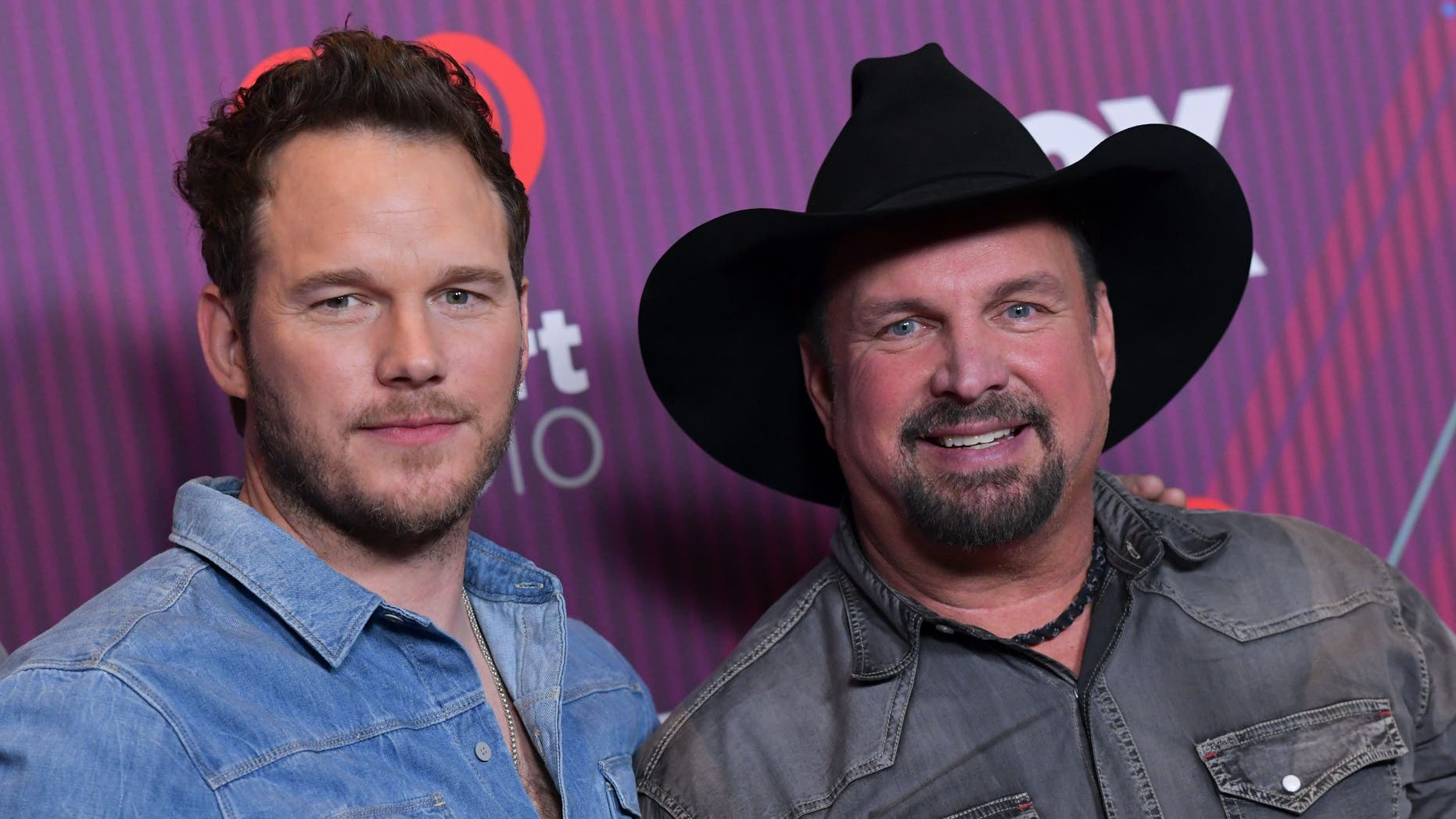 Garth Brooks and Chris Pratt poise in a press room during a 2019 iHeart Radio Music Awards in Los Angeles on Thursday.