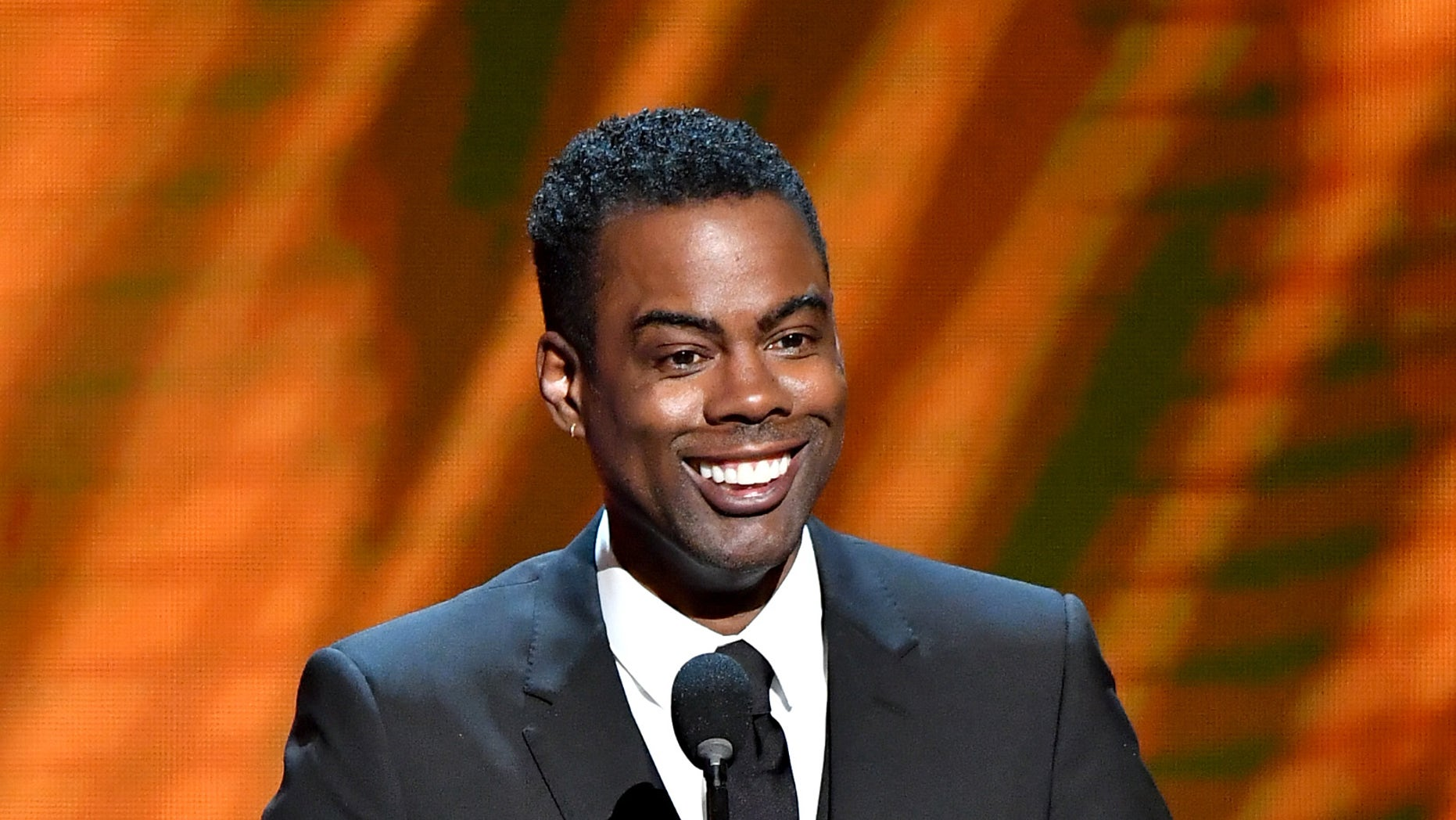 """Chris Rock speaks on stage at the 50th NAACP Image Awards at the Dolby Theater in Hollywood, California, March 30, 201<div class=""""e3lan e3lan-in-post1""""><script async src=""""//pagead2.googlesyndication.com/pagead/js/adsbygoogle.js""""></script> <!-- Text_Display_Responsive --> <ins class=""""adsbygoogle""""      style=""""display:block""""      data-ad-client=""""ca-pub-6192903739091894""""      data-ad-slot=""""3136787391""""      data-ad-format=""""auto""""      data-full-width-responsive=""""true""""></ins> <script> (adsbygoogle = window.adsbygoogle    []).push({}); </script></div>9. (Getty Images)"""