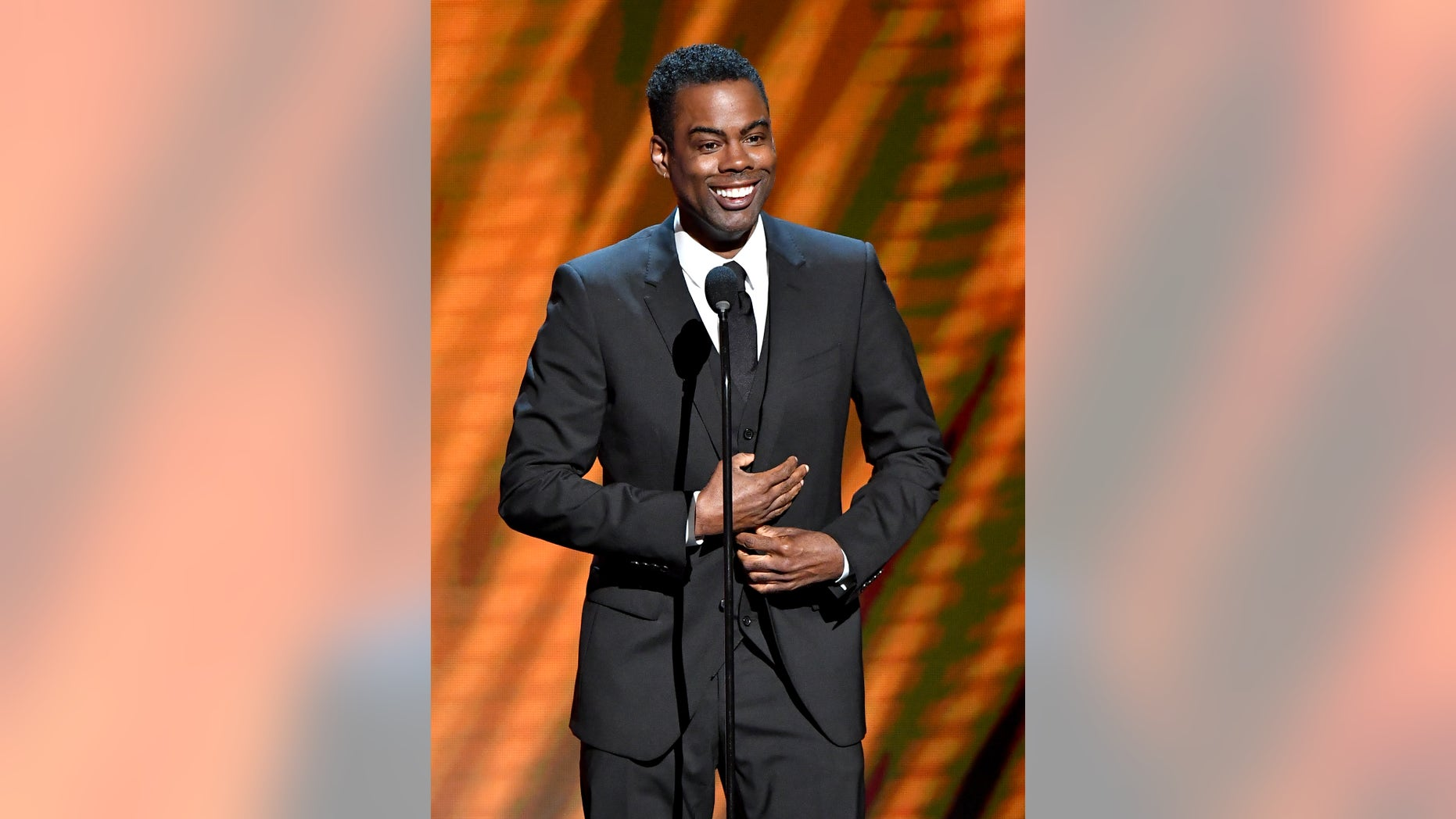 """Chris Rock speaks on stage at the 50th NAACP Image Awards at the Dolby Theater in Hollywood, California, March 30, 201<div class=""""e3lan e3lan-in-post1""""><script async src=""""//pagead2.googlesyndication.com/pagead/js/adsbygoogle.js""""></script> <!-- Text_Display_Ad --> <ins class=""""adsbygoogle""""      style=""""display:block""""      data-ad-client=""""ca-pub-7542518979287585""""      data-ad-slot=""""2196042218""""      data-ad-format=""""auto""""></ins> <script> (adsbygoogle = window.adsbygoogle 
