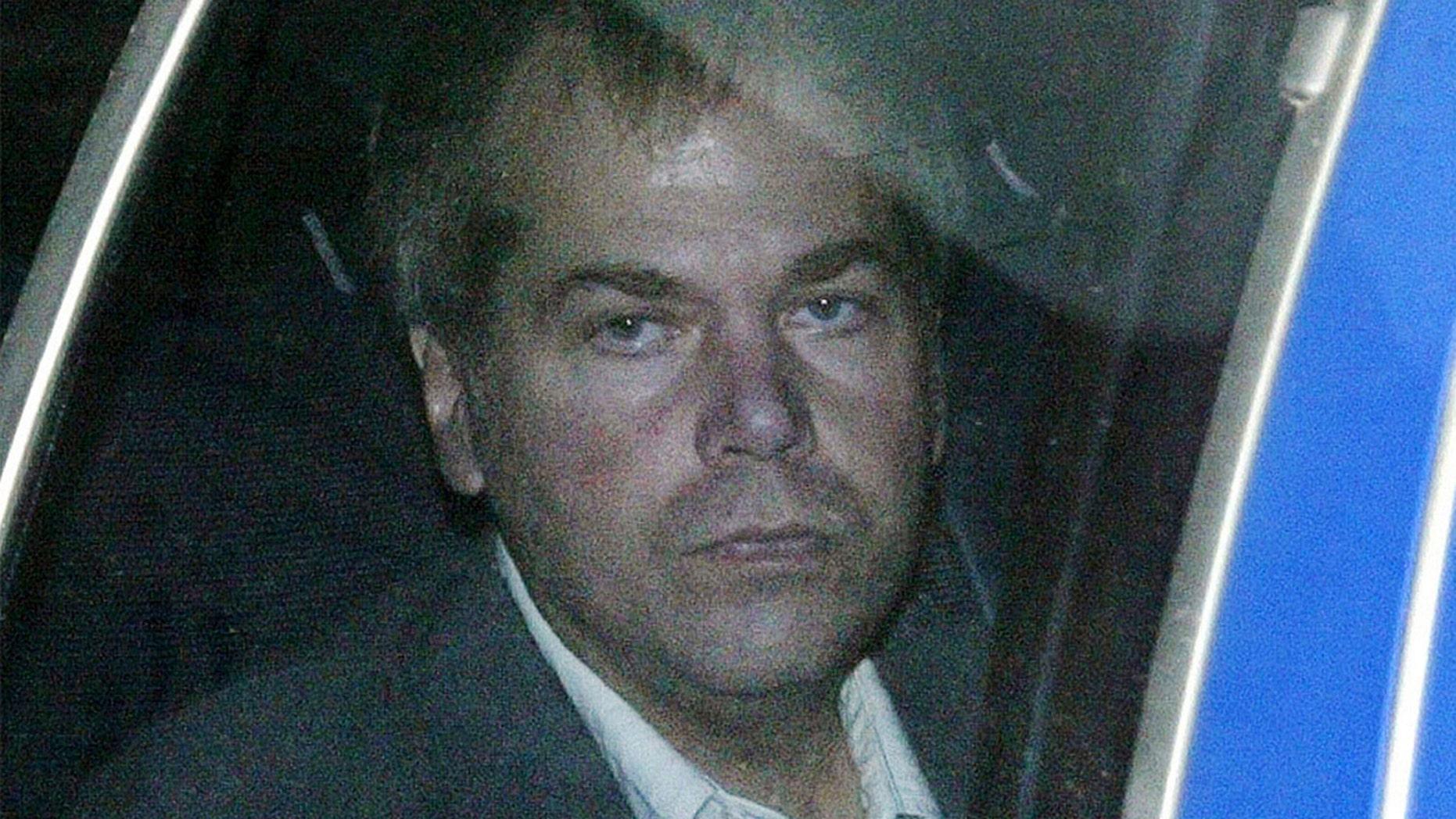 In this Nov. 18, 2003, file photo, John Hinckley Jr. arrives at U.S. District Court in Washington.