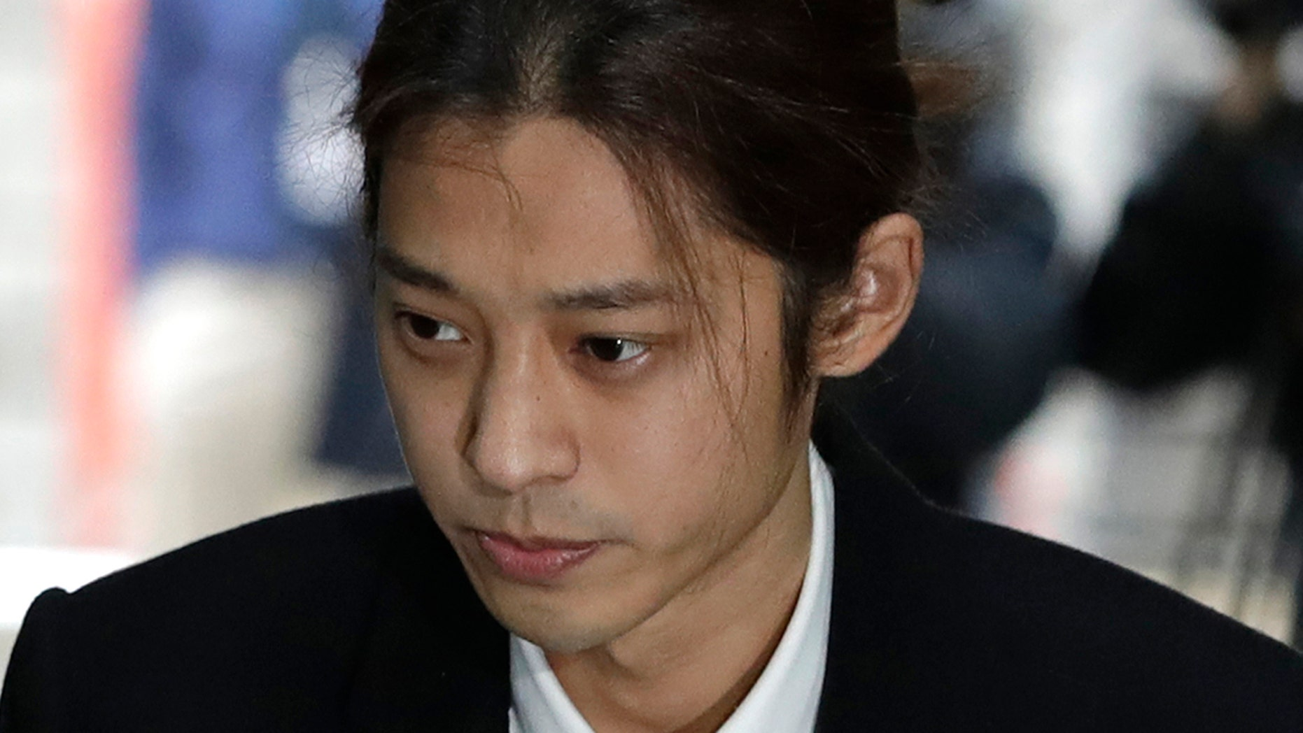 K-pop singer Jung Joon-young arrives to attend a hearing at the Seoul Central District Court in Seoul, South Korea, Thursday, March 21, 2019. A South Korean pop star has appeared at a court hearing to decide whether to arrest him over allegations that he illegally shared sexually explicit videos of women taken without their knowledge or consent in online group chats.