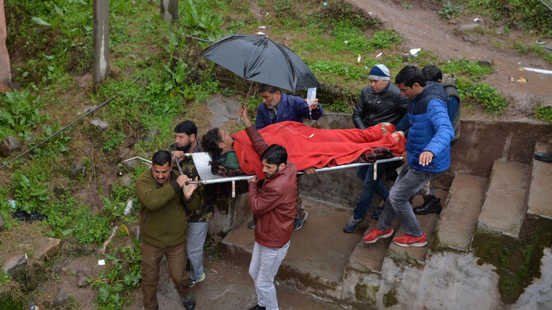 An injured man is carried on a stretcher at a hospital in the Indian Kashmir frontier town of Mendhar on March 2, 2019, after being wounded in his home when it was struck by a mortar shell that his family said was fired by Pakistan troops along the Line of Control (LoC) that divides Kashmir between India and Pakistan