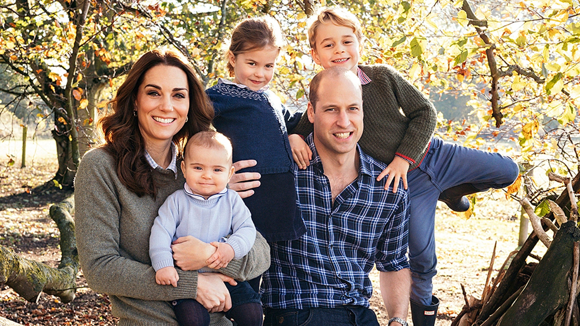Britain's Prince William and Kate, Duchess of Cambridge with their children Prince George, right, Princess Charlotte, center, and Prince Louis.