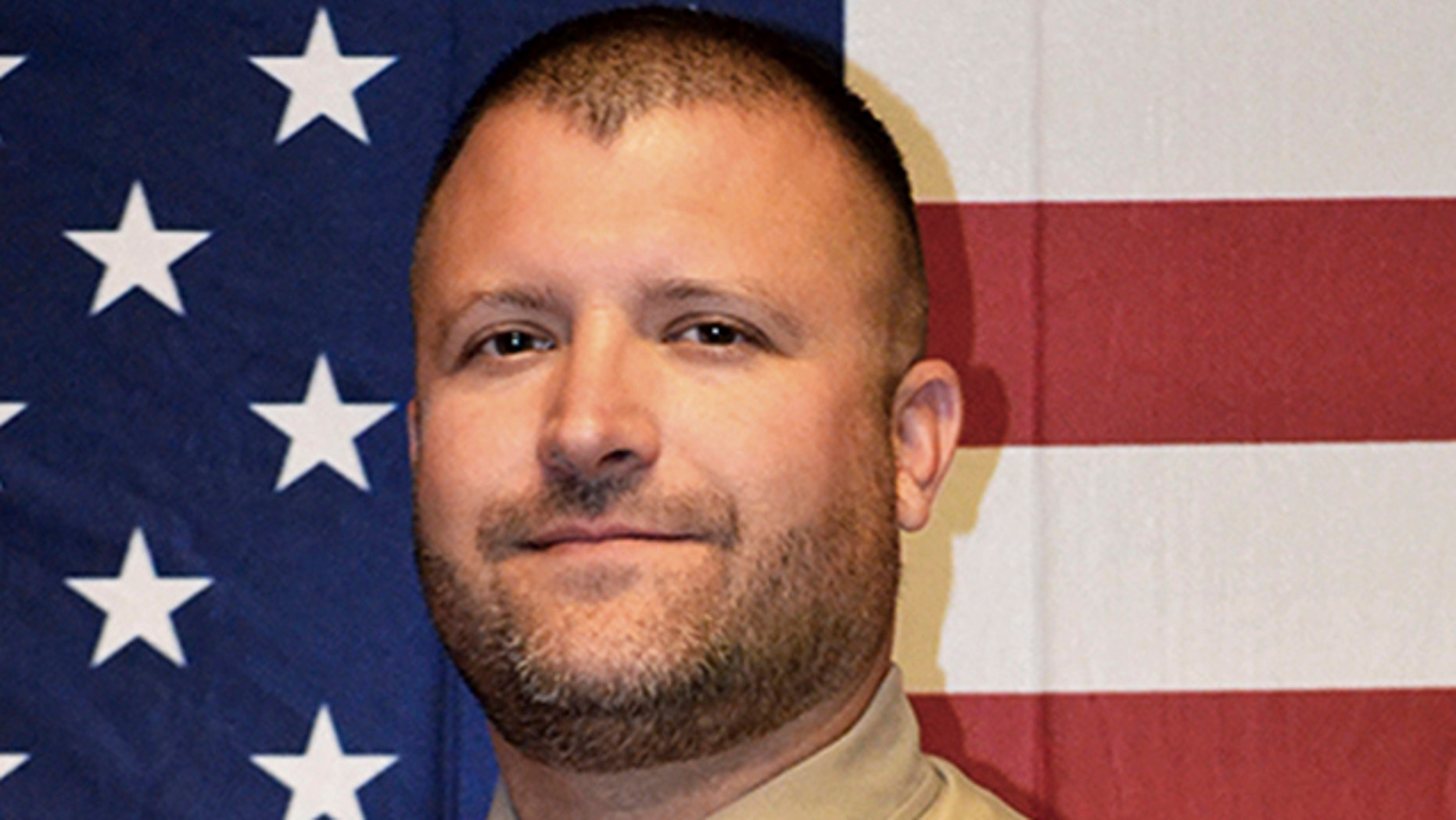 Deputy Ryan Thompson, 42, was shot and killed and a police officer was wounded after they exchanged gunfire with a road rage driving suspect Tuesday. (Kittitas County Sheriff's Office via AP)