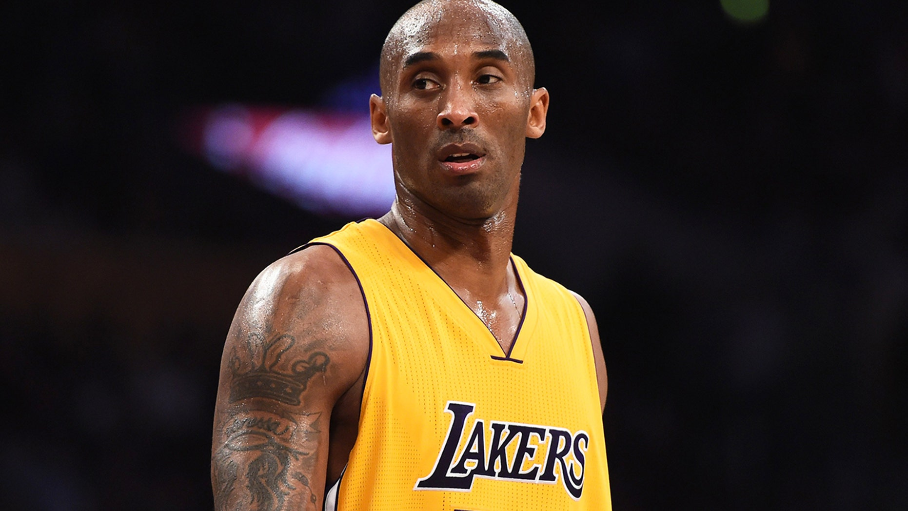 FILE: Kobe Bryant (24) of the Los Angeles Lakers looks on during the Lakers NBA match up with the Toronto Raptors, November 20, 2015 at Staples Center in Los Angeles, California. The Raptors defeated the Lakers 102-91.