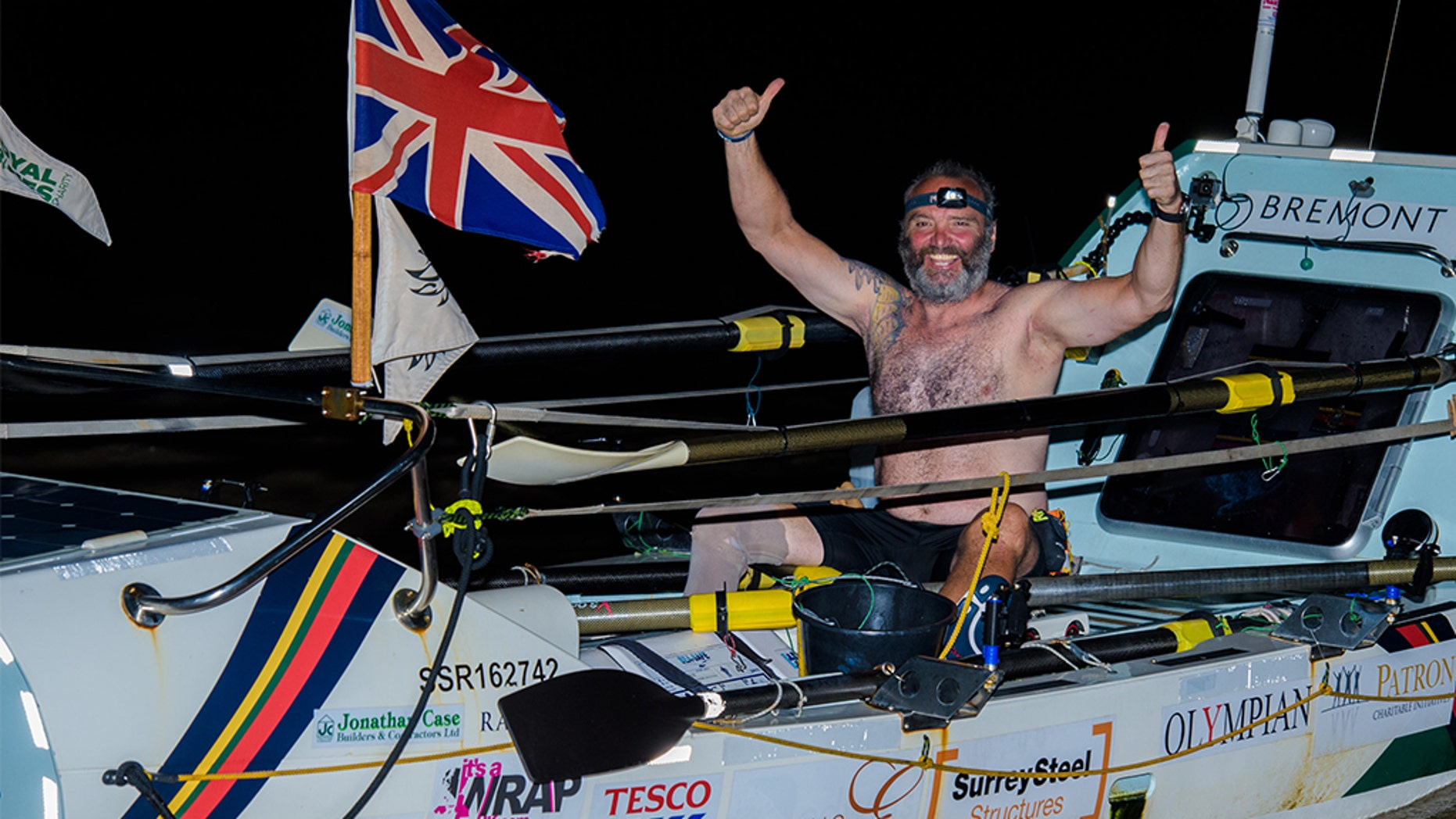 Lee Spencer celebrates after arriving in Cayenne, French Guiana early Monday. (Photo by Anthony Upton/ Rowing Marine via Getty Images)