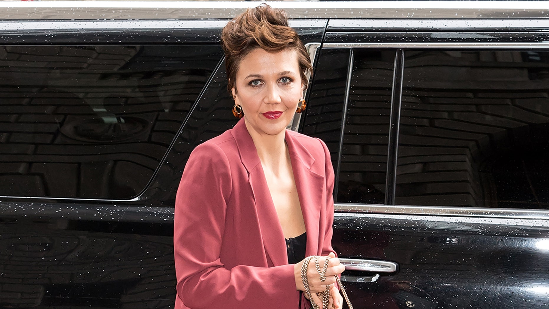 Actress Maggie Gyllenhaal fired back at a writer who commented on her high-pitched 'cartoonish' voice.