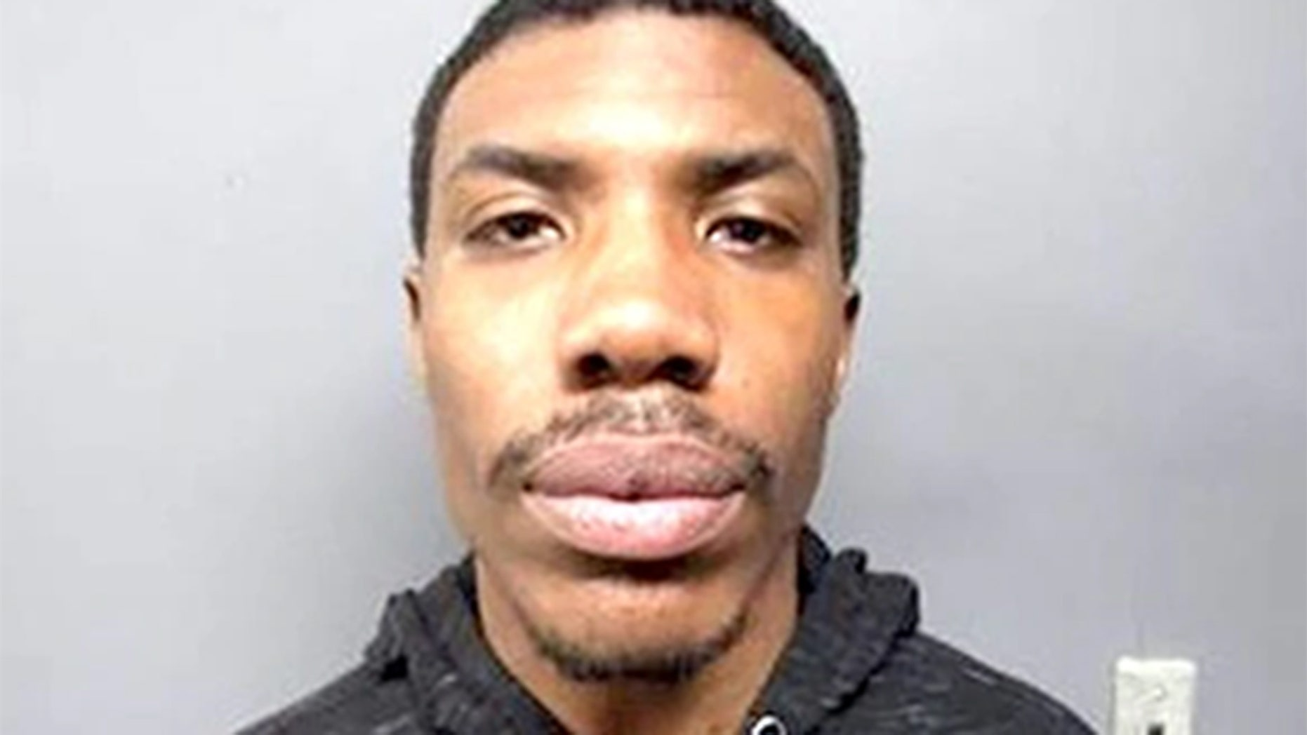 Malik Evans, 23, is accused of stealing an unattended running vehicle in Hackensack, N.J. He was tracked down with the help of footprints in the snow.