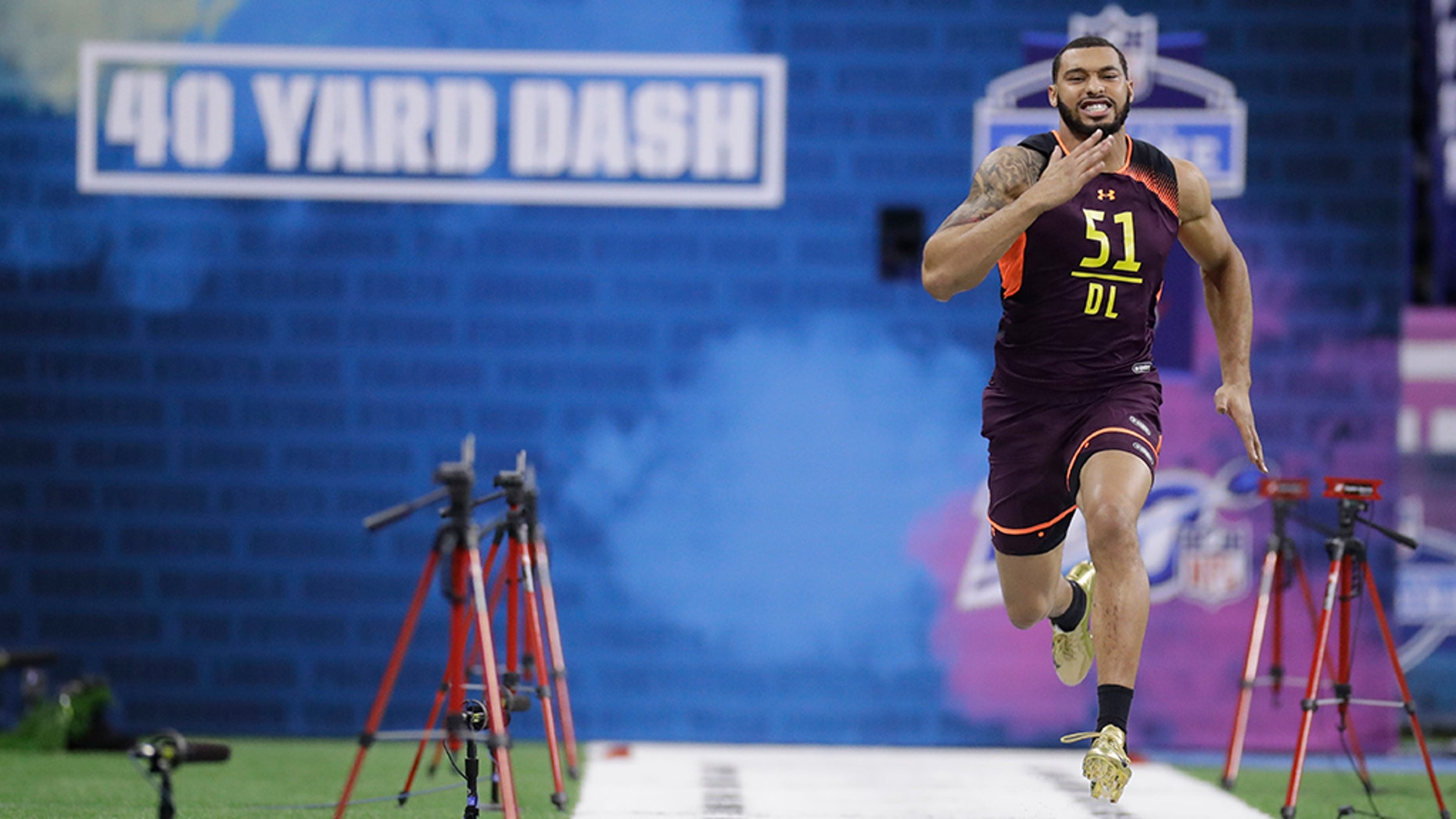 Mississippi State defensive lineman Montez Sweat runs a 40-yard lurch during a NFL football scouting brew Sunday in Indianapolis. (AP Photo/Darron Cummings)