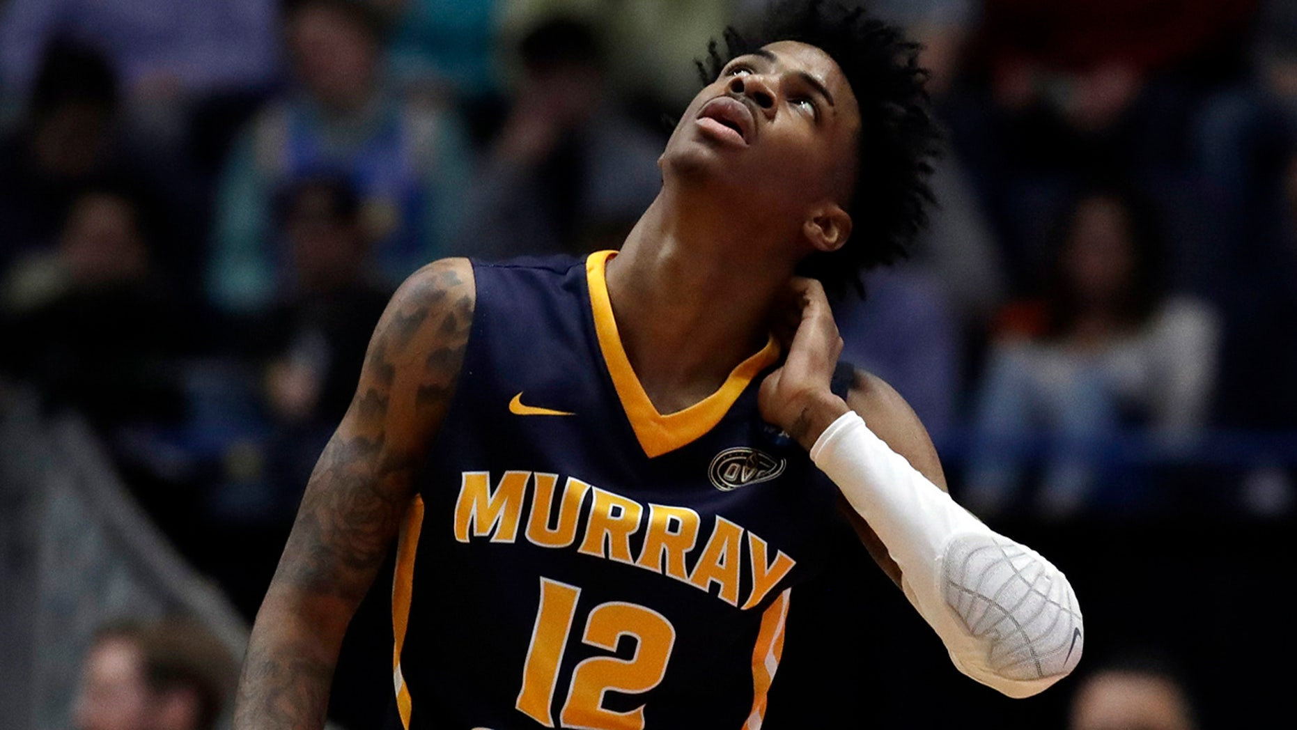 Murray State's Ja Morant (12) looks up at the scoreboard during the first half of a second-round men's college basketball game against Florida State in the NCAA Tournament, Saturday, March 23, 2019, in Hartford, Conn. (Associated Press)