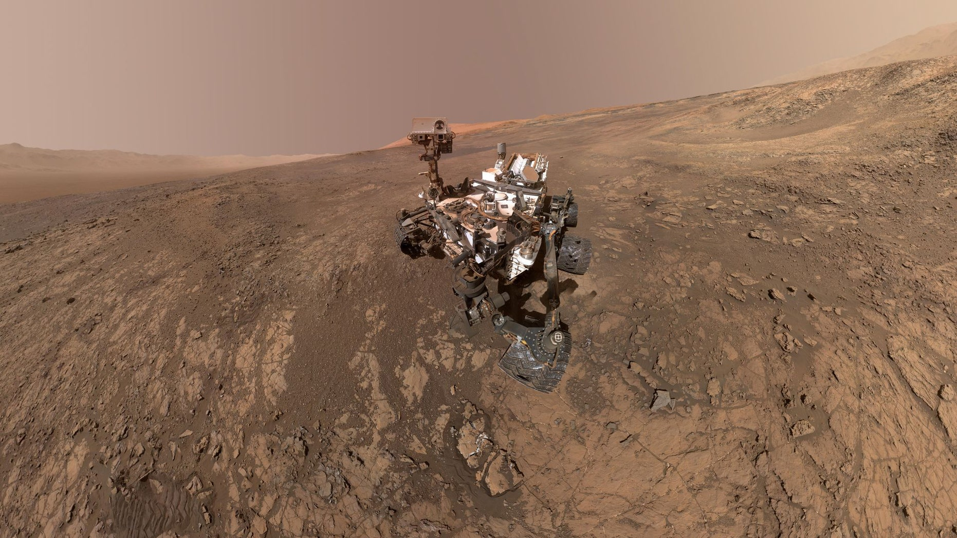 This self-portrait of NASA's Curiosity Mars rover shows the vehicle on Vera Rubin Ridge in Gale crater on Mars. North is on the left and west is on the right with Gale crater's rim on the horizon of both edges. This mosaic was assembled from dozens of