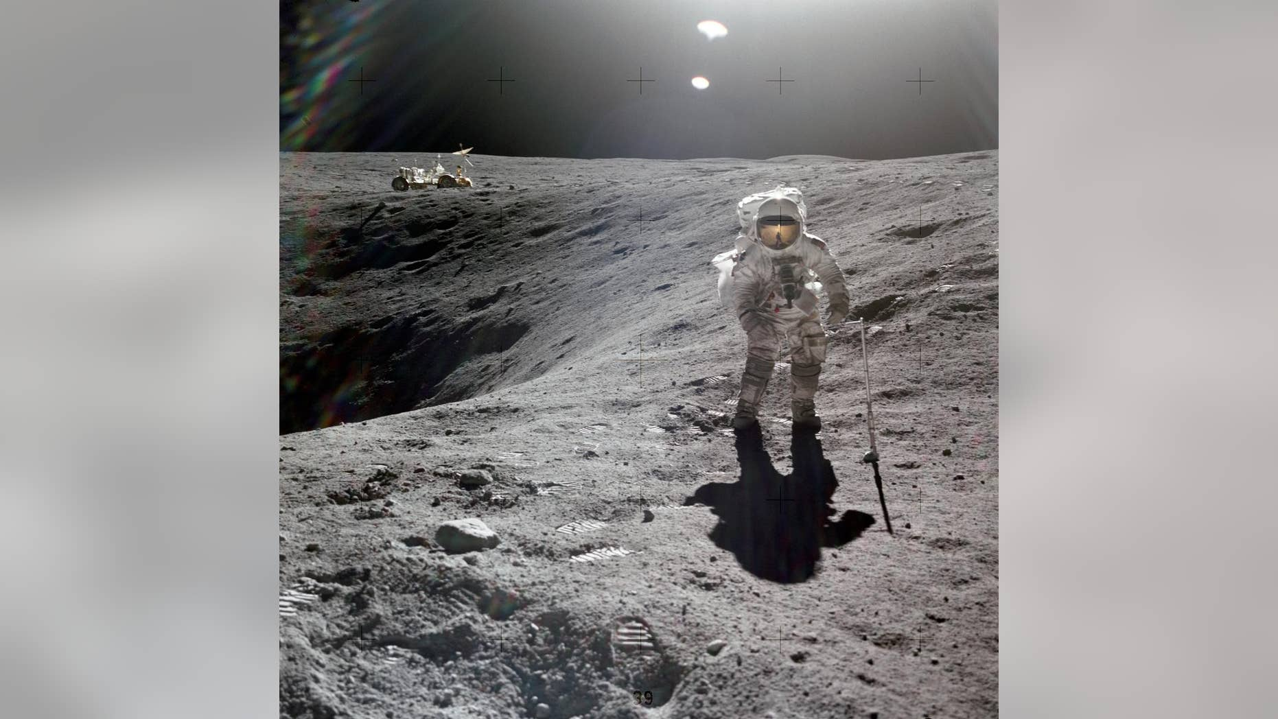 Charles Duke, Apollo 16's lunar module pilot, is photographed collecting lunar samples at Station No. 1, during the first Apollo 16 extravehicular activity (EVA), at the Descartes landing site. (NASA)