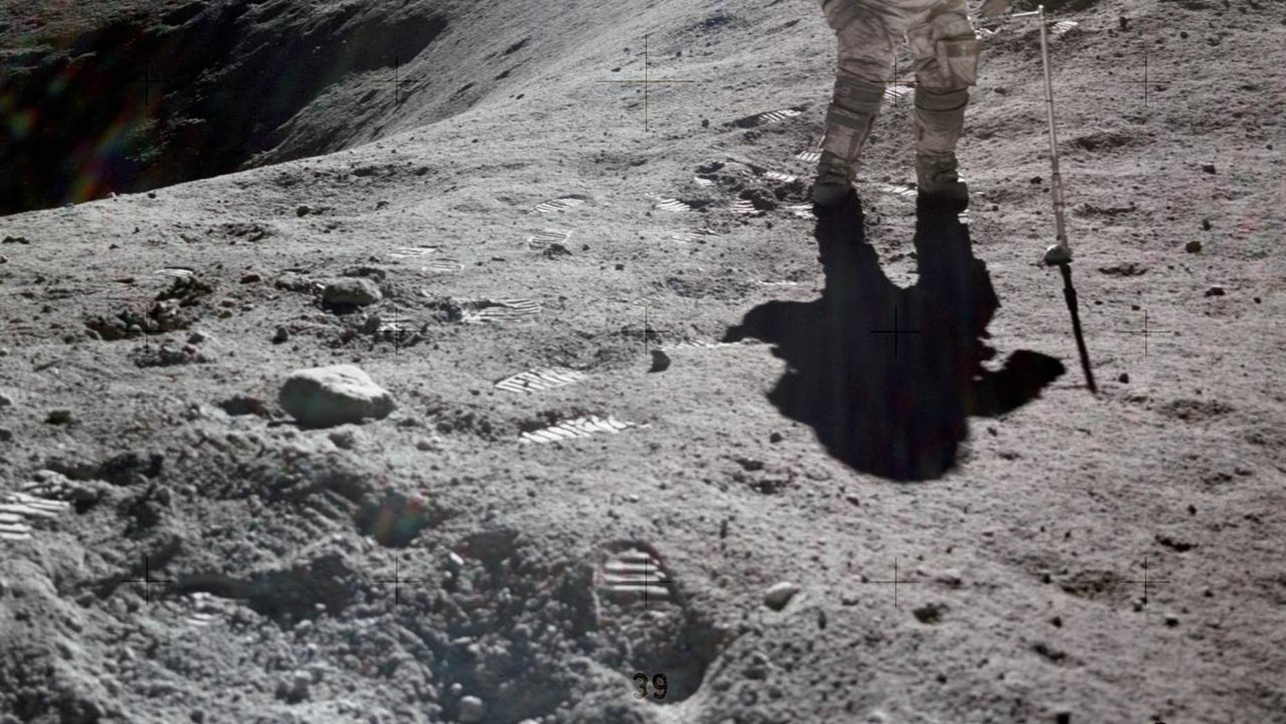 Charles Duke, Apollo 16's lunar procedure pilot, is photographed collecting lunar samples during Station No. 1, during a initial Apollo 16 extravehicular activity (EVA), during a Descartes alighting site. (NASA)