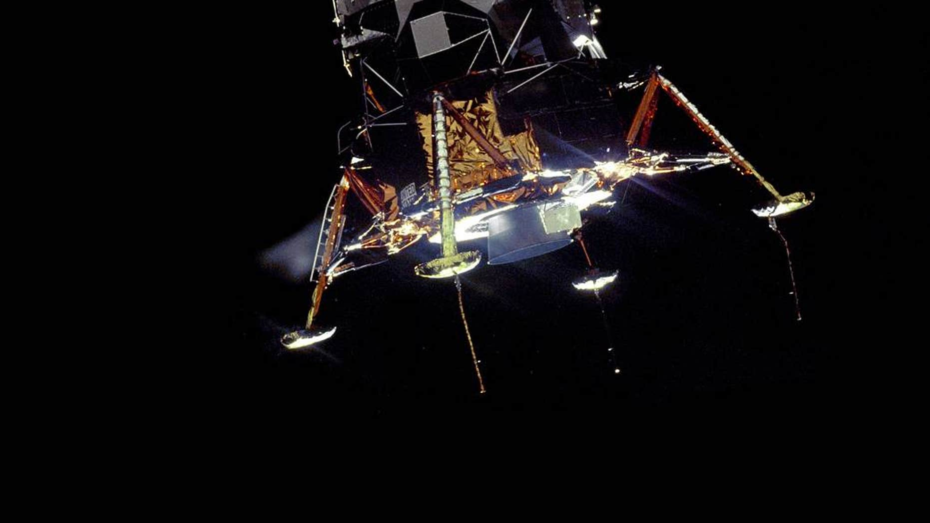 File print - The Apollo 11 Lunar Module Eagle, in a alighting configuration, photographed from a Command and Service Module Columbia.(NASA)