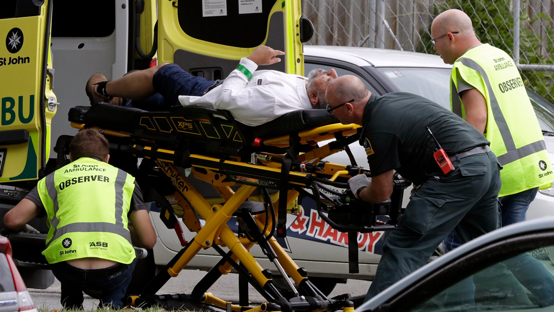 Ambulance staff takes a man outside a mosque in downtown Christchurch, New Zealand, Friday, March 15, 2019. A witness says many people have been killed in a mass photography at a mosque in New Zealand, Christchurch. (Associated Press)