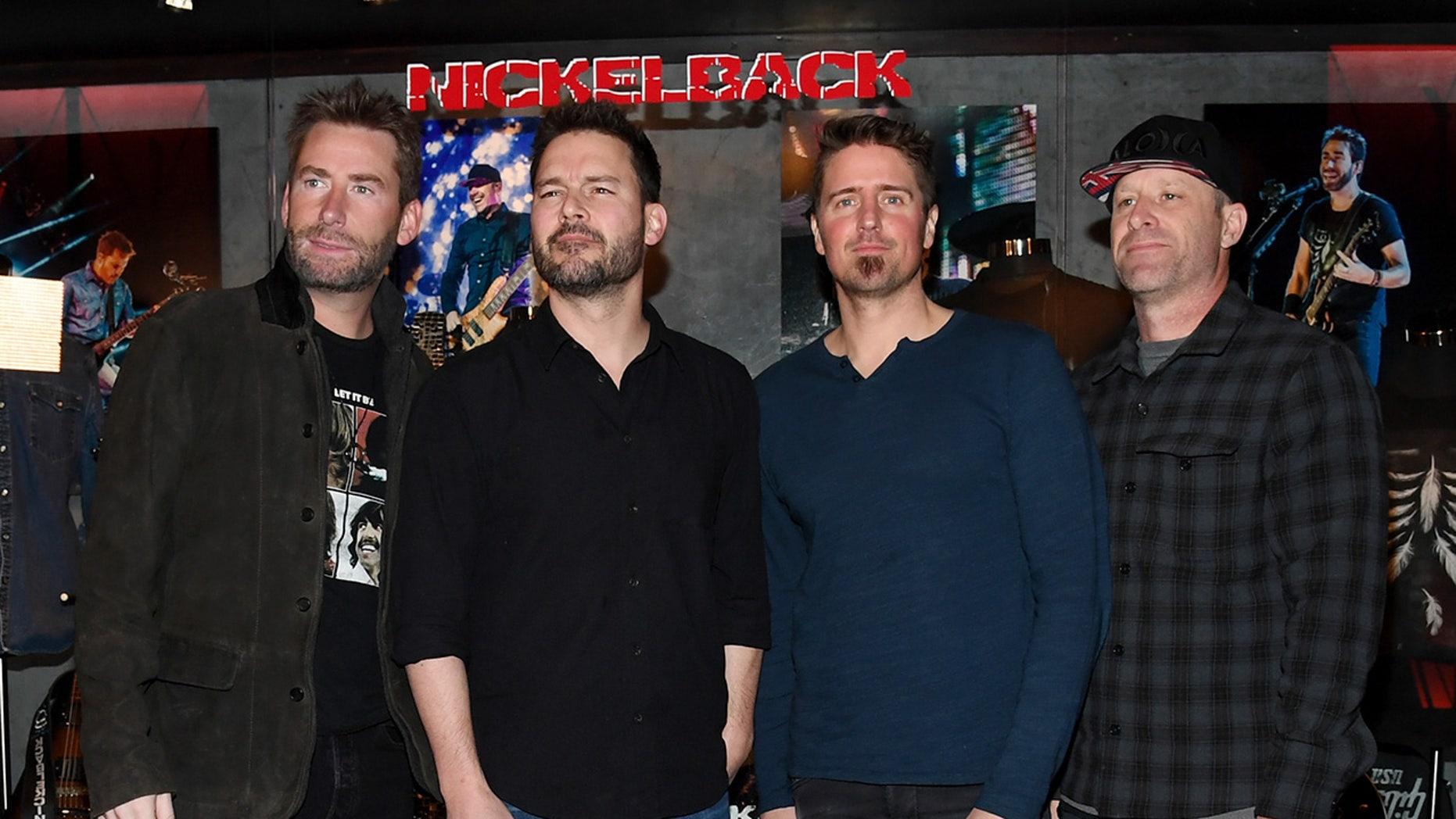 Frontman Chad Kroeger, guitarist Ryan Peake, drummer Daniel Adair and bassist Mike Kroeger of Nickelback attend a memorabilia case dedication on Feb. 22, 2018 in Las Vegas. (Getty)