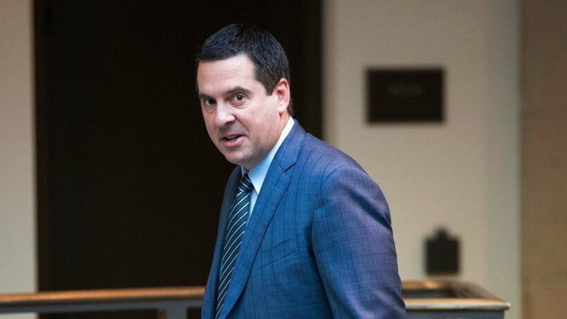 """FILE - In this Feb. 27, 2018 file photo, House Intelligence Committee Chairman Devin Nunes, R-Calif., a close ally of President Donald Trump, arrives at the Capitol in Washington. Nunes is suing Twitter and several of its users for more than $250 million, accusing them of defamation and negligence. The suit filed Monday, March 18, 2019, in Virginia accuses Twitter of """"knowingly hosting and monetizing content that is clearly abusive, hateful and defamatory."""" (AP Photo/J. Scott Applewhite, File)"""
