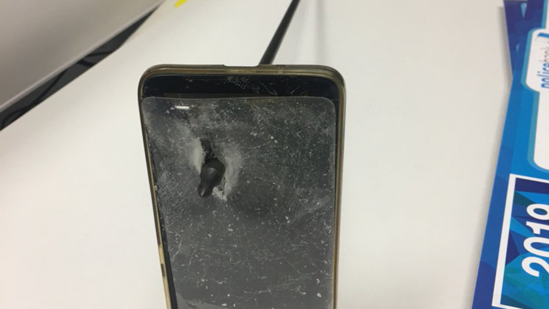 An Australian man was able to block an arrow from hitting him after his phone become a shield, police said.