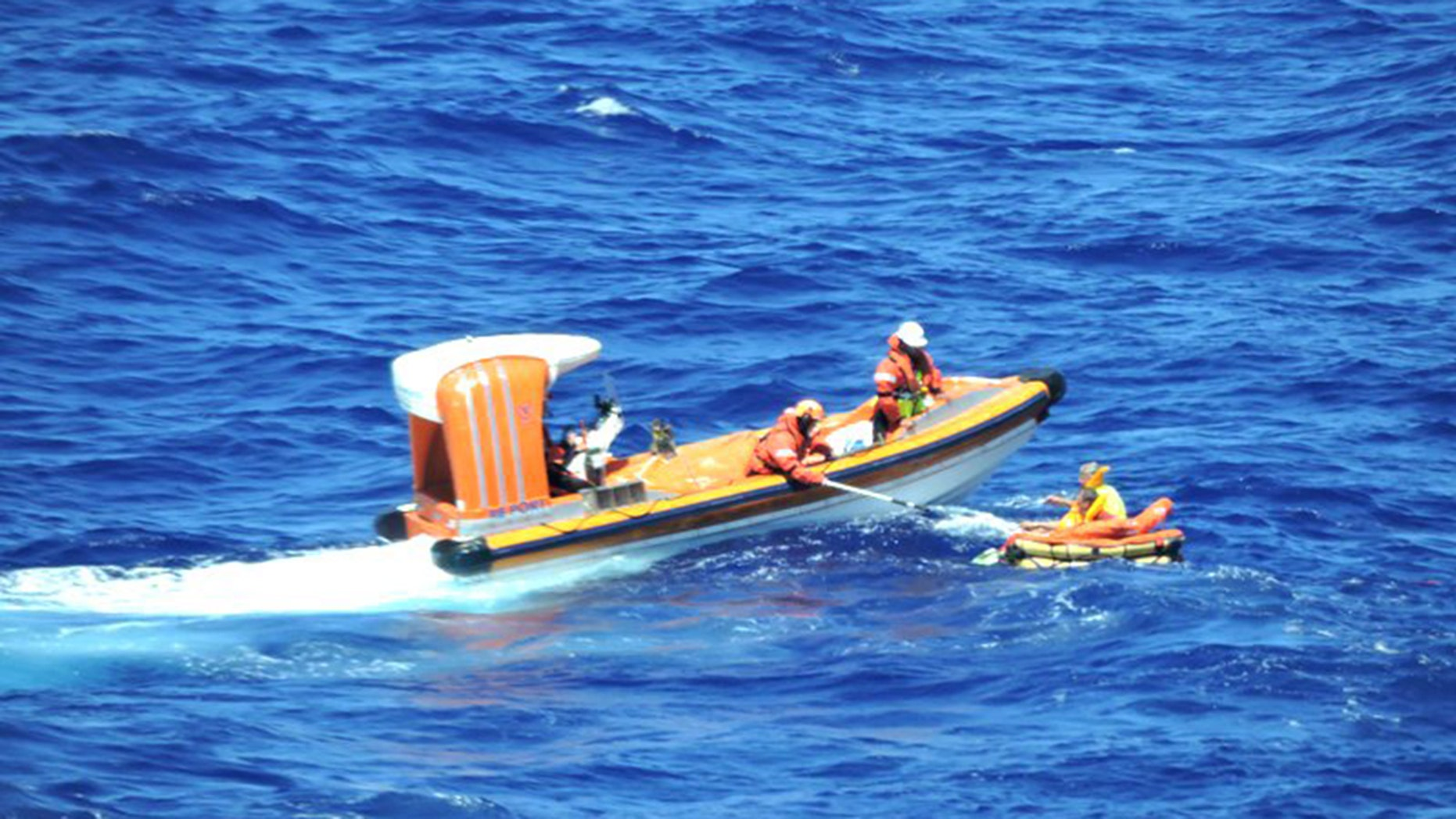 The cruise sent out a dinghy to retrieve the men as passengers aboard the Regal Princess watched and cheered from the ship's deck.
