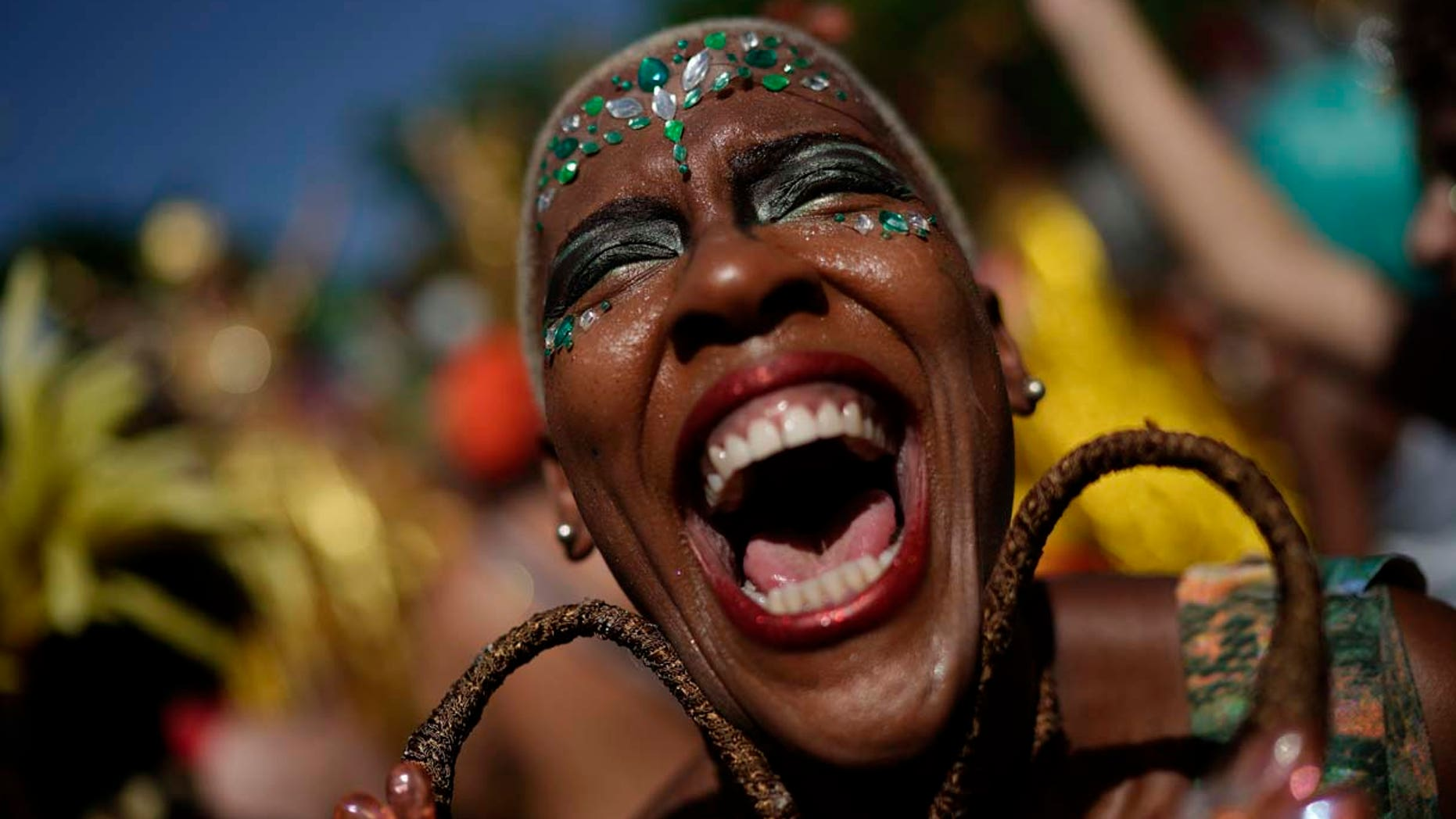 "A reveler in costume laughs during the ""Cordao do Boitata"" street party in Rio de Janeiro, Brazil, Sunday, Feb. 24, 2019, one of the many parades before the official start of Carnival on March 1. (AP Photo/Leo Correa)"