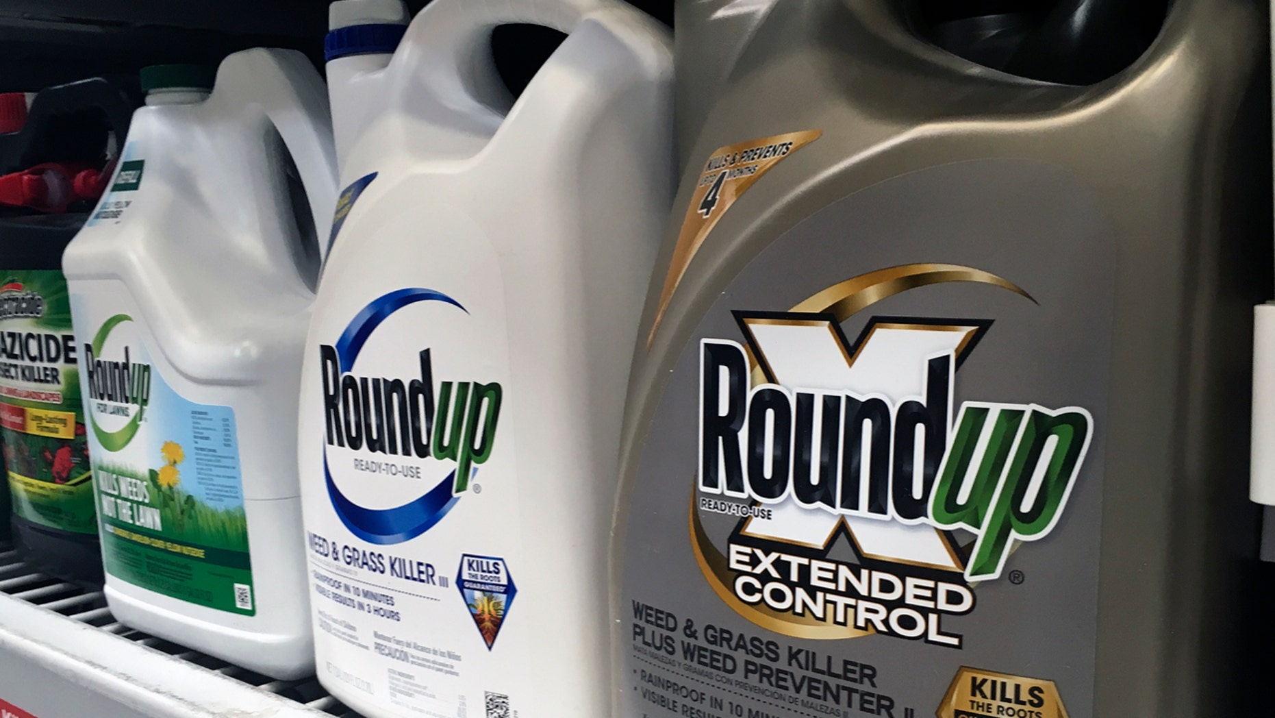 FILE - In this Sunday, Feb. 24, 2019 record photo, containers of Roundup are displayed on a store shelf in San Francisco. (AP Photo/Haven Daley, File)